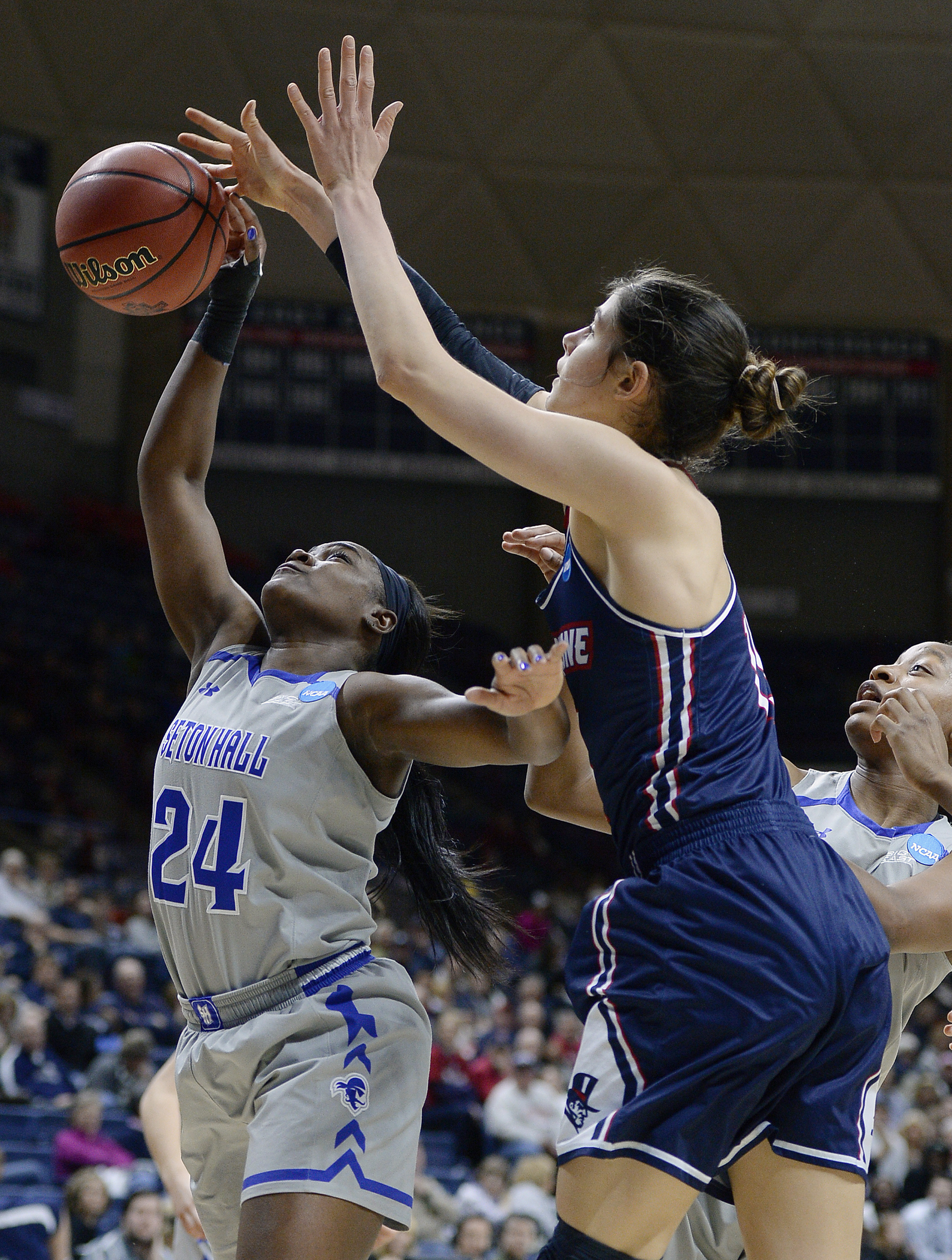 Seton Halls Shakena Richardson, left, grabs a rebound over Duquesnes Amadea Szamosi, right, during the first half of a first-round women's college basketball game in the NCAA Tournament, Saturday, March 19, 2016, in Storrs, Conn. (AP Photo/Jessica Hill)