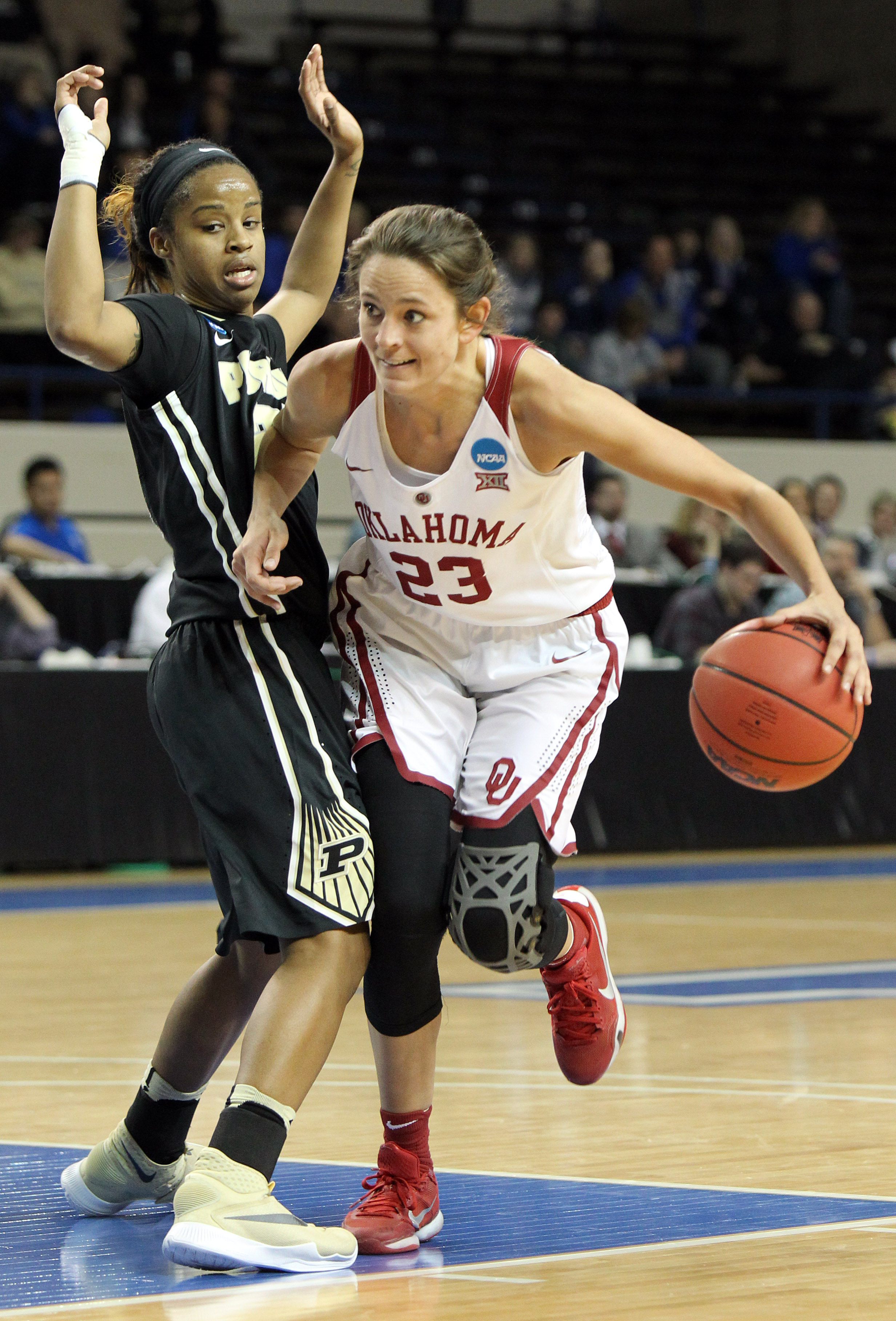 Oklahoma's Maddie Manning (23) looks for an opening on Purdue's Abby Abel during a first-round women's college basketball game in the NCAA Tournament in Lexington, Ky., Saturday, March 19, 2016. (AP Photo/James Crisp)