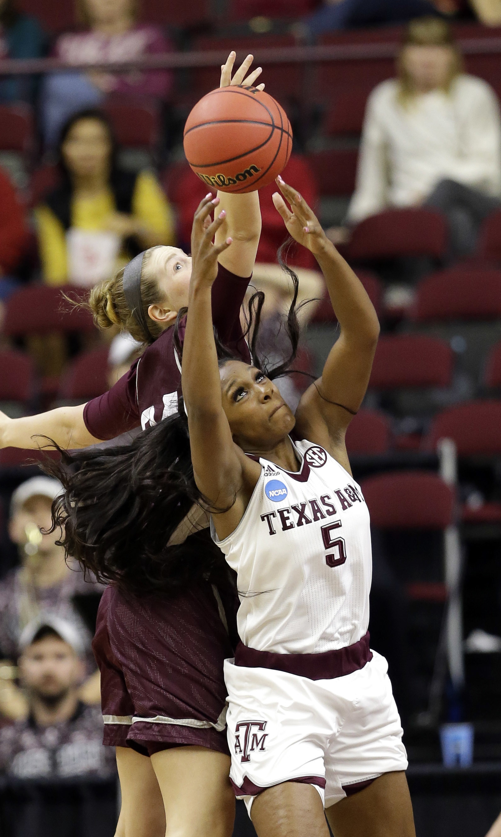 Texas A&M's Anriel Howard (5) pulls down a rebound in front of Missouri State's Rachel Swartz during the second half of a first-round women's college basketball game in the NCAA Tournament Saturday, March 19, 2016, in College Station, Texas. Texas A&M won