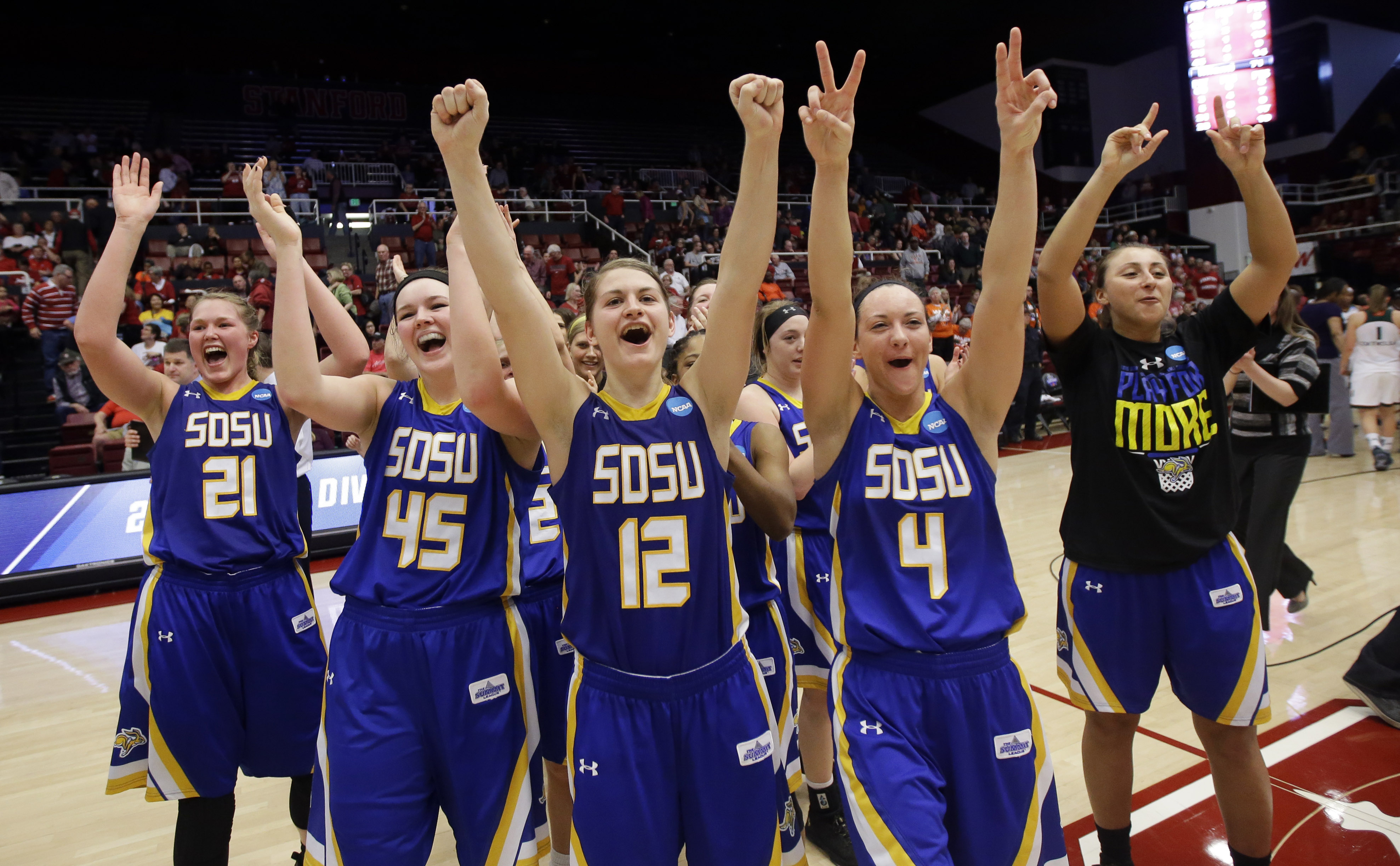 South Dakota State players celebrate after a 74-71 win over Miami in a first-round women's college basketball game in the NCAA Tournament Saturday, March 19, 2016, in Stanford, Calif. (AP Photo/Marcio Jose Sanchez)