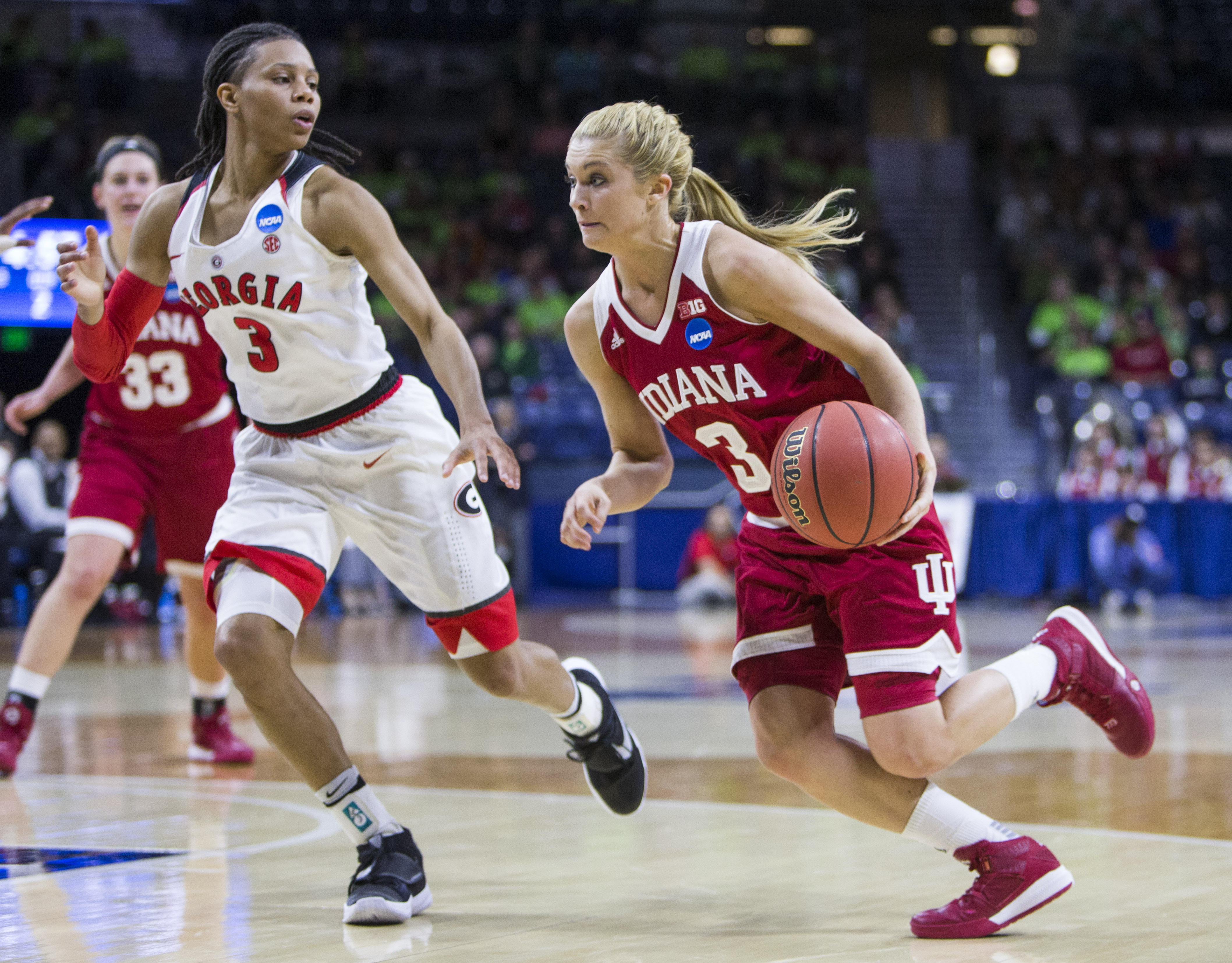 Indianas TyraBuss (3), right, drives by Georgias Tiaria Griffin (3) during the first half of a first-round women's college basketball game in the NCAA Tournament, Saturday, March 19, 2016, in South Bend, Ind. (AP Photo/Robert Franklin)