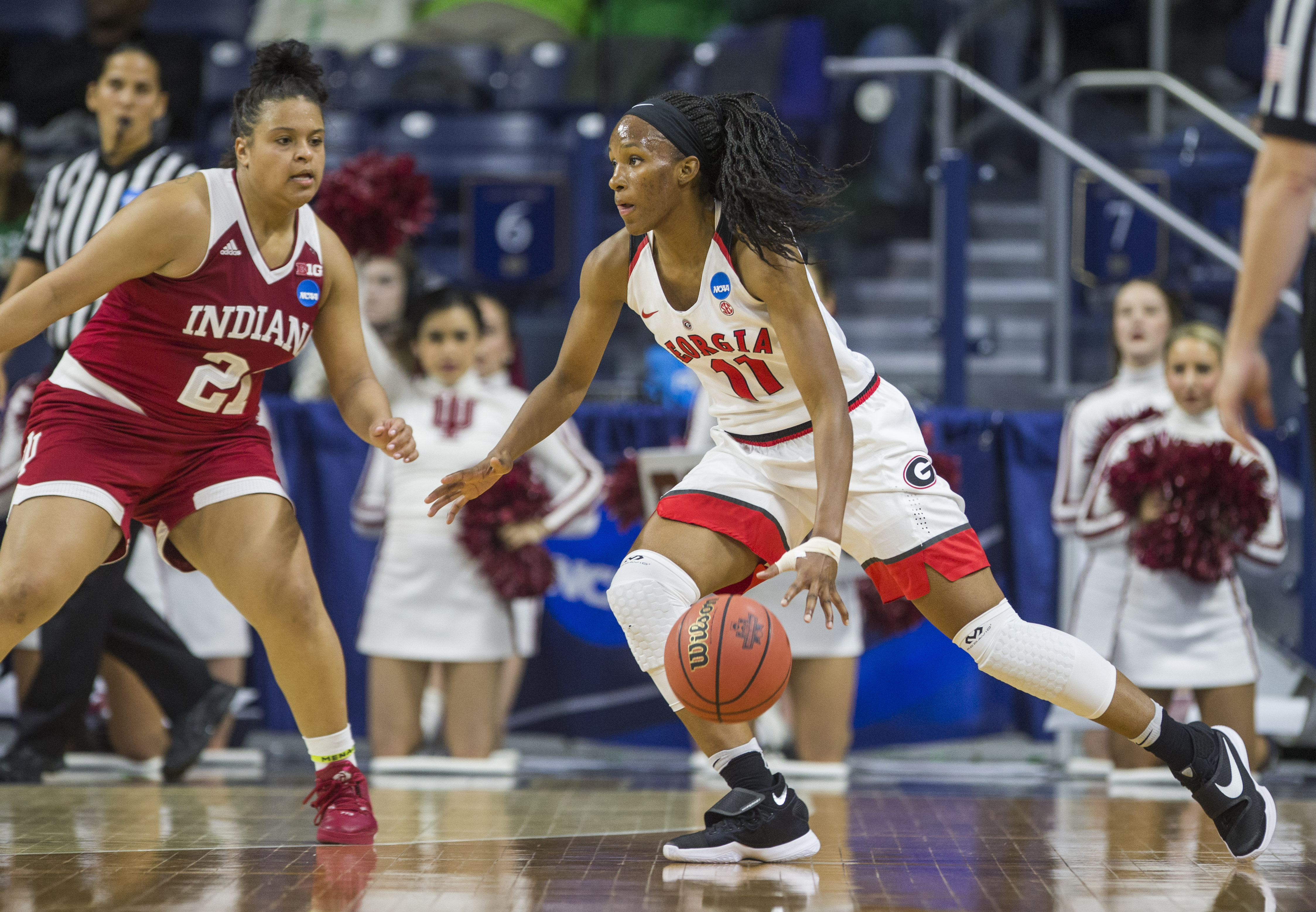 Georgias Pachis Roberts (11) drives around Indianas KarleeMcBride (21) during the first half of a first-round women's college basketball game in the NCAA Tournament, Saturday, March 19, 2016, in South Bend, Ind. (AP Photo/Robert Franklin)