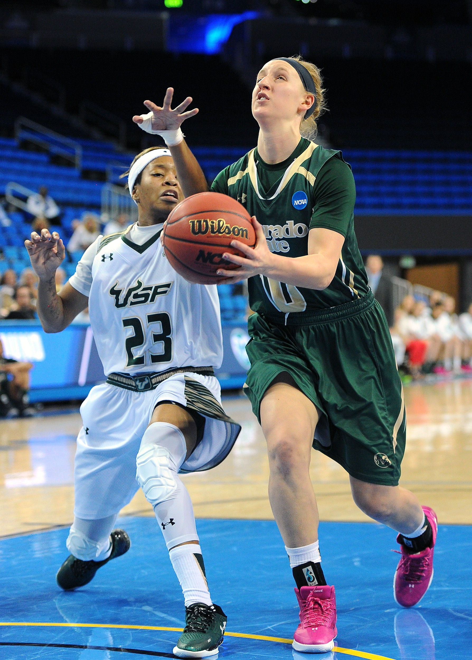 Colorado State's Hannah Tvrdy (10) drives on South Florida's Shalethia Stringfield (23) during a first-round women's college basketball game in the NCAA Tournament in Los Angeles, Saturday, March 19, 2016. (AP Photo/Michael Owen Baker)