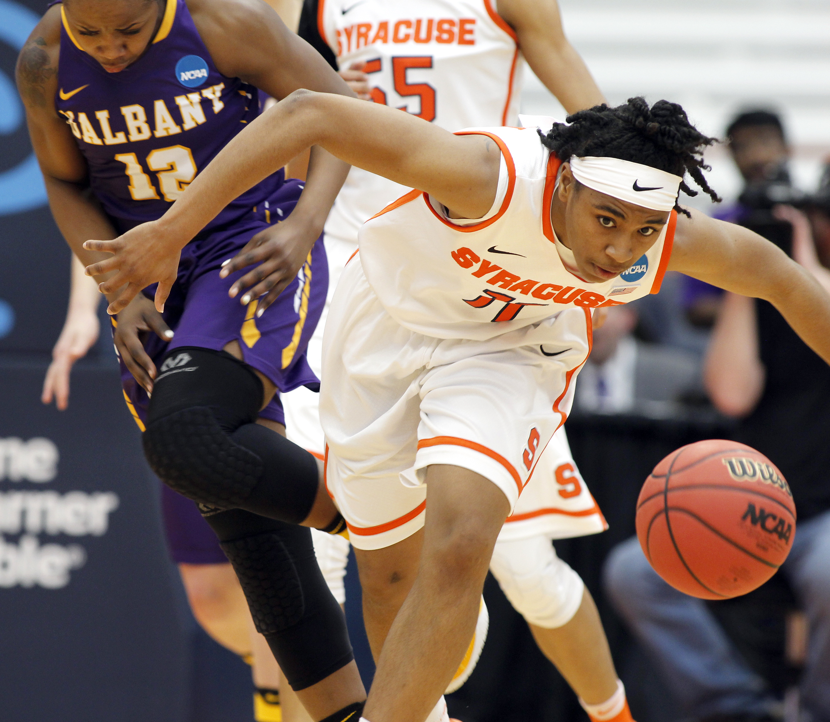 Syracuses Cornelia Fondren, right, dives for the ball past Albanys Imani Tate, left, in the first quarter of a second-round womens college basketball game in the NCAA Tournament in Syracuse, N.Y., Sunday, March 20, 2016. (AP Photo/Nick Lisi)