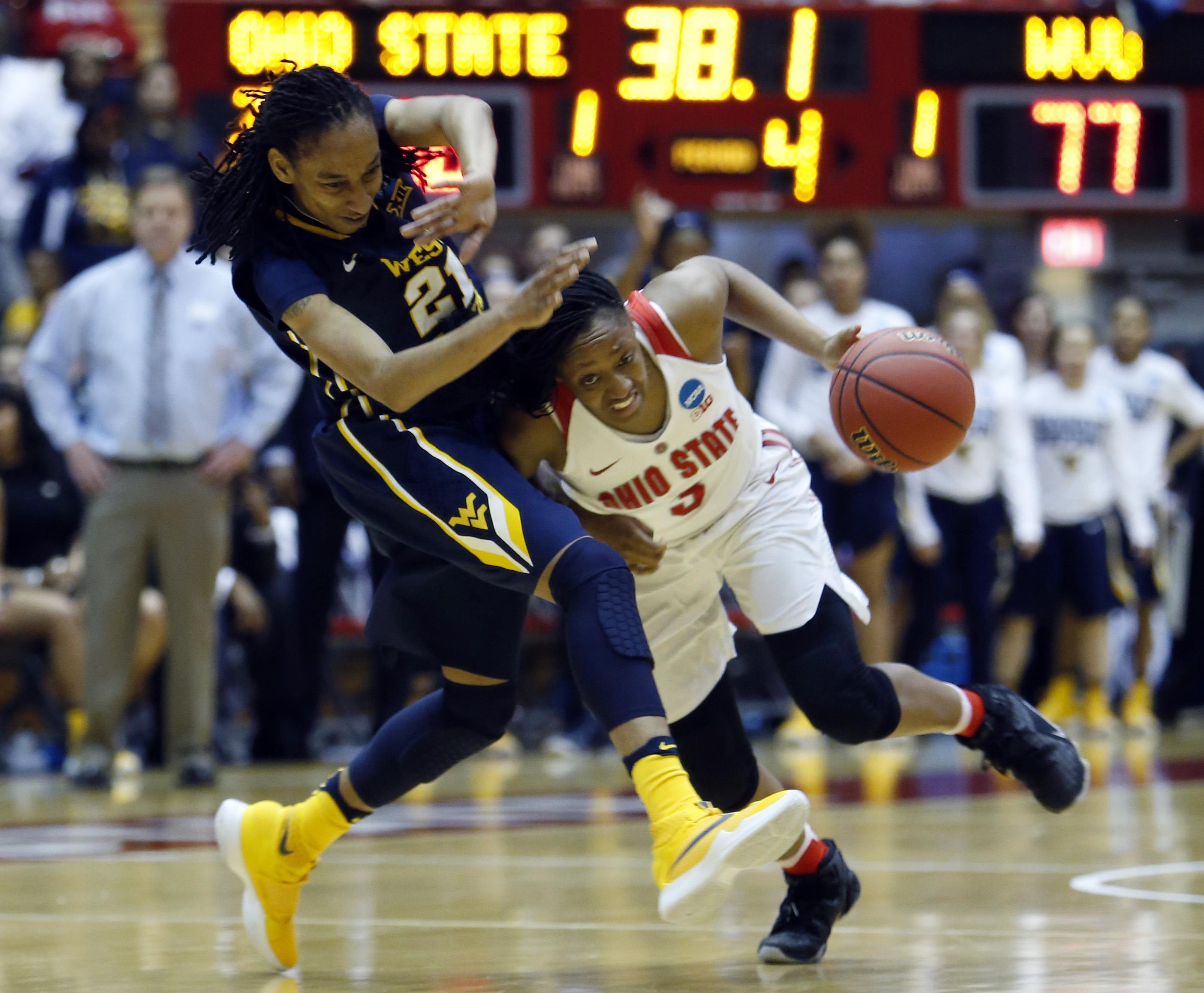 Ohio State's Kelsey Mitchell, right, drives to the basket against West Virginia's Jessica Morton during a second-round women's college basketball game in the NCAA Tournament Sunday, March 20, 2016, in Columbus, Ohio. (AP Photo/Jay LaPrete)