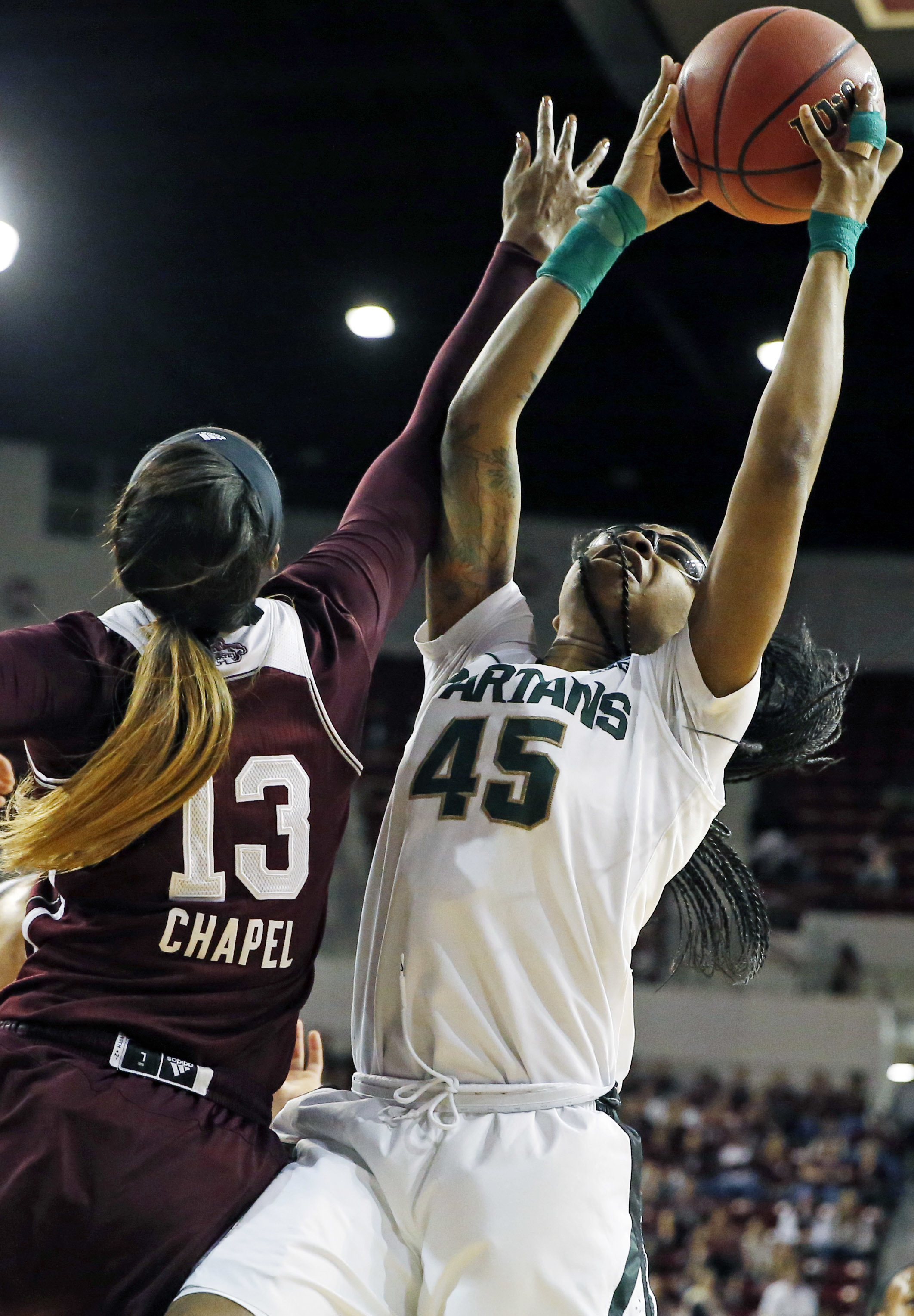 Michigan State forward Akyah Taylor (45) pulls down a rebound past Mississippi State forward Ketara Chapel (13) during the first half in a second-round women's college basketball game in the NCAA Tournament, Sunday, March 20, 2016, in Starkville, Miss. (A