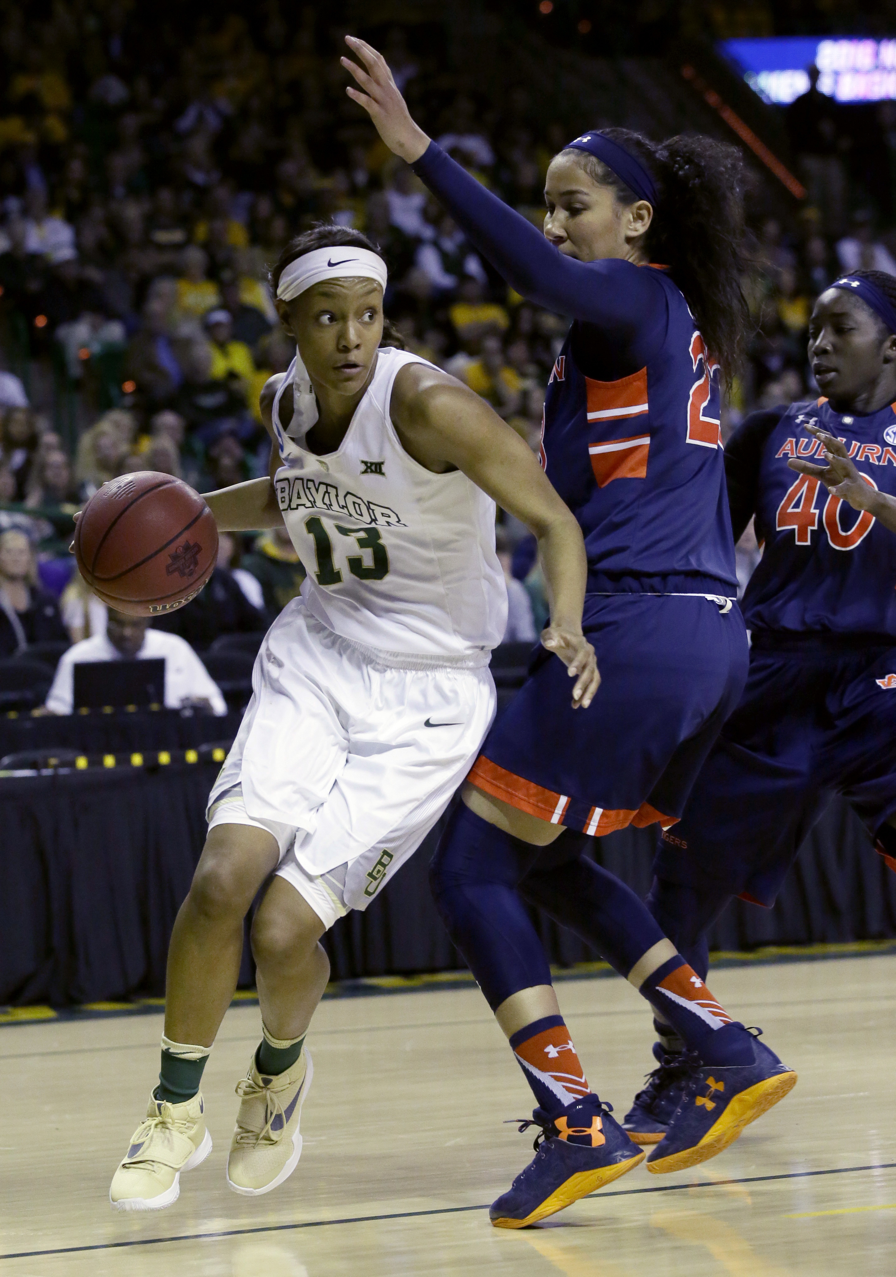 Baylor forward Nina Davis (13) drives against Auburn defenders Jessica Jones (23) and Khady Dieng (40) during the first half of a second-round women's college basketball game in the NCAA Tournament Sunday, March 20, 2016, in Waco, Texas. (AP Photo/LM Oter