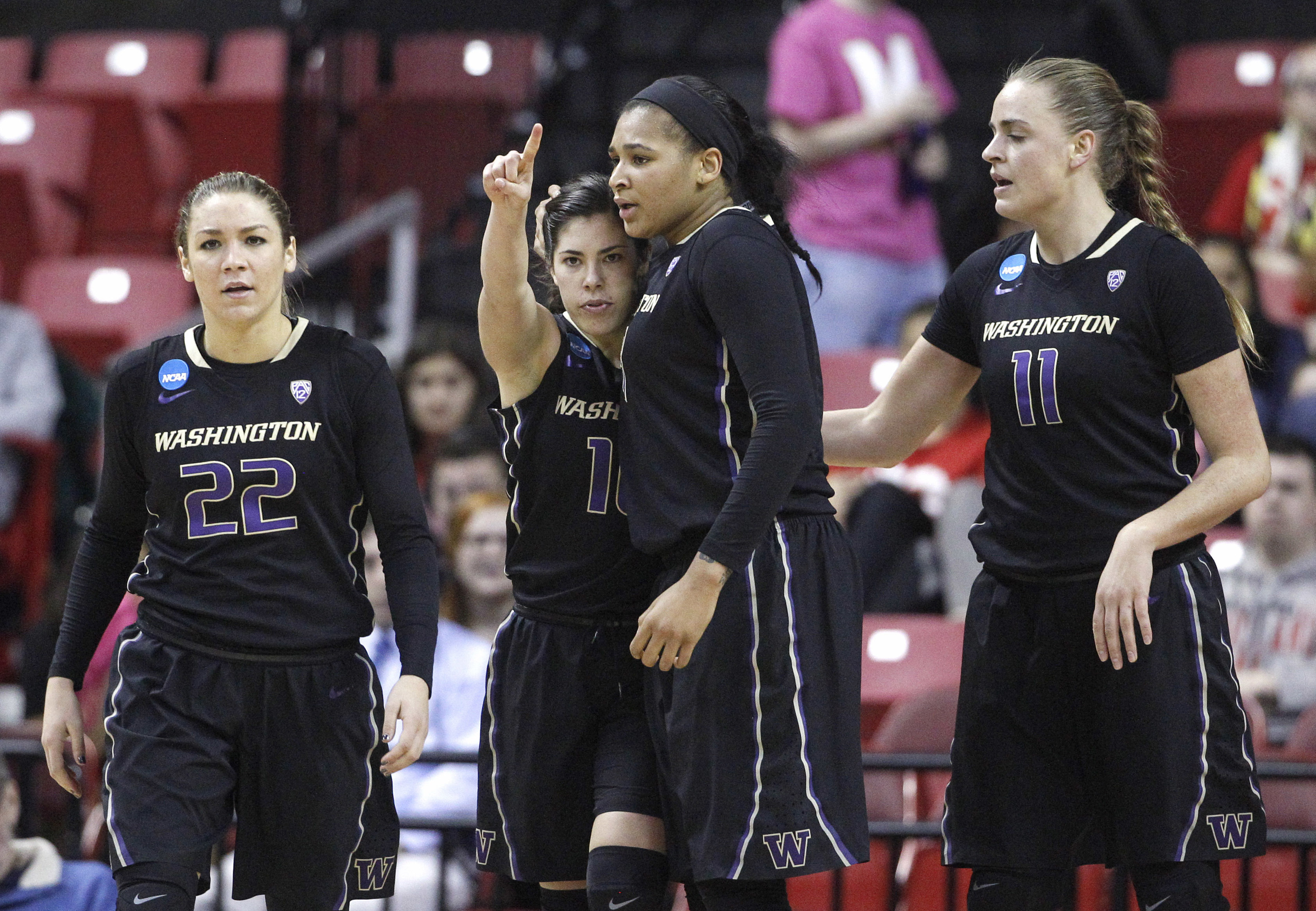 Washington guard Kelsey Plum, second from left, gestures after being fouled while shooting in the second half of an NCAA college basketball game against Maryland in the second round of the NCAA tournament, Monday, March 21, 2016, in College Park, Md. Also