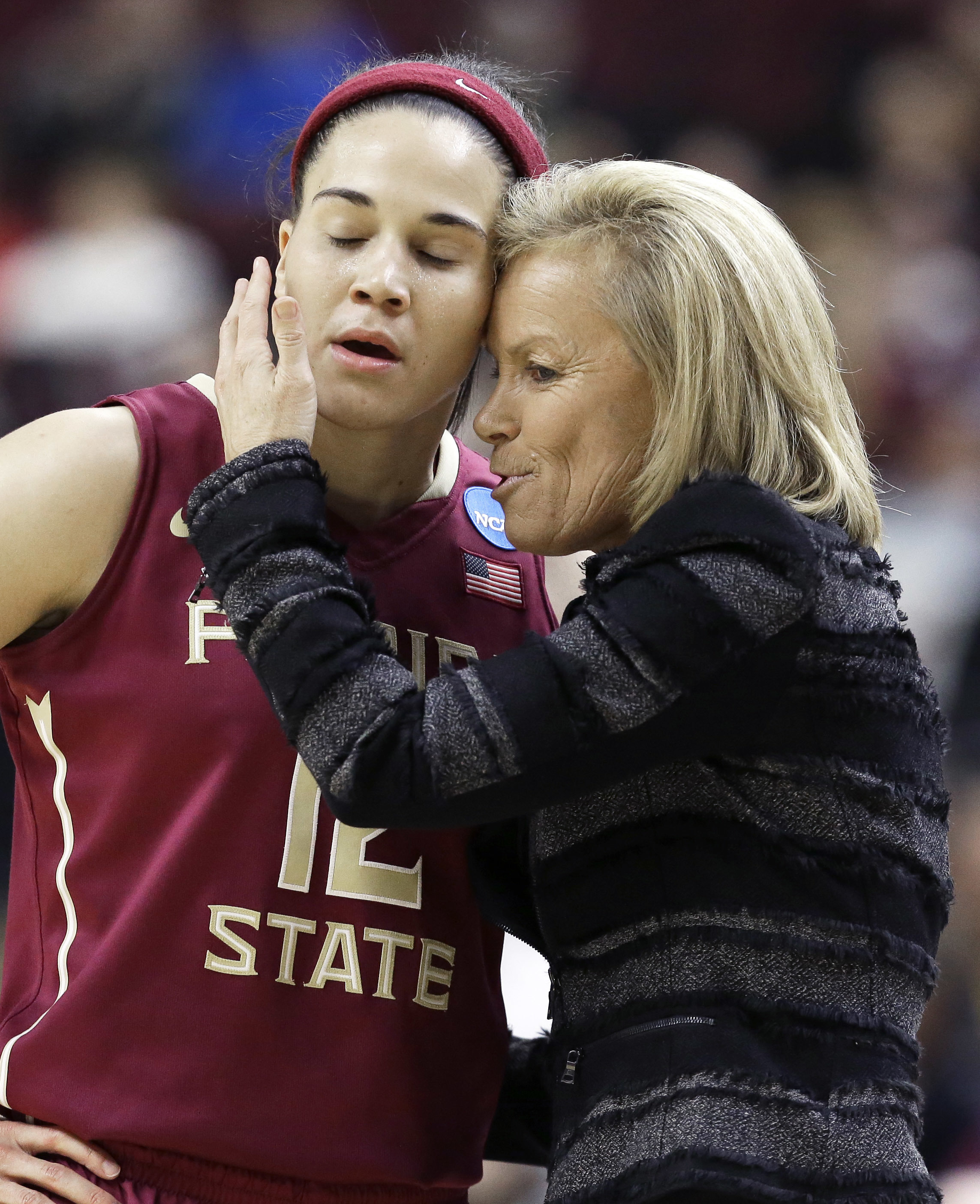 Florida State head coach Sue Semrau, right, talks to Brittany Brown during the second half of a college basketball game against Texas A&M in the second round of the NCAA tournament Monday, March 21, 2016, in College Station, Texas. Florida State won 74-56