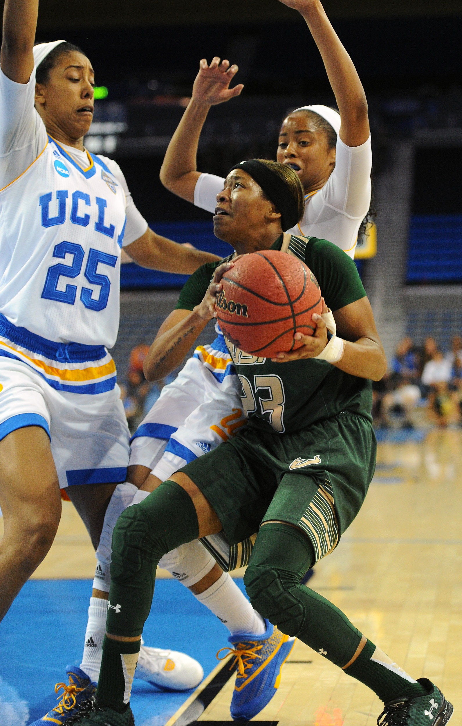 South Florida's Nancy Warioba, right, runs into the double team of UCLA's Monique Billings (25) and Jordin Canada during a second-round women's college basketball game in the NCAA Tournament in Los Angeles, Monday, March 21, 2016. (AP Photo/Michael Owen B