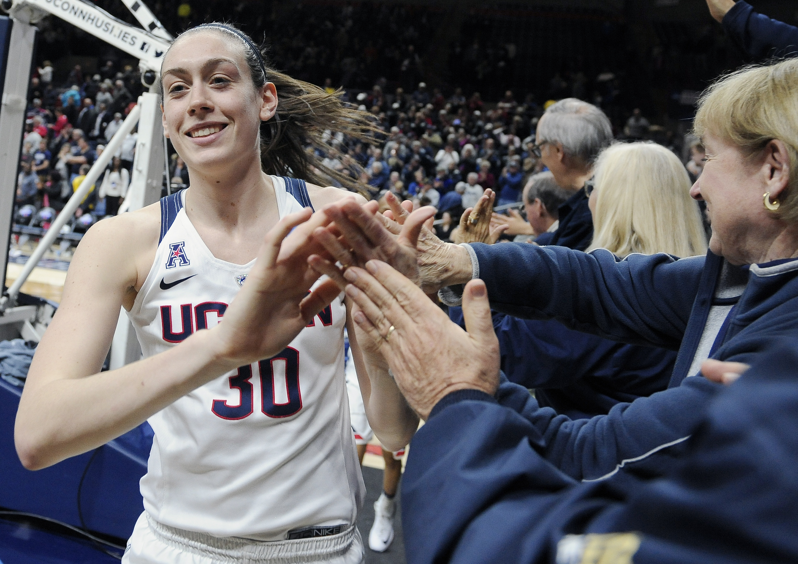 Connecticuts Breanna Stewart greets fans at the end of a second round women's college basketball game against Duquesne in the NCAA Tournament, Monday, March 21, 2016, in Storrs, Conn. UConn won 97-51. (AP Photo/Jessica Hill)