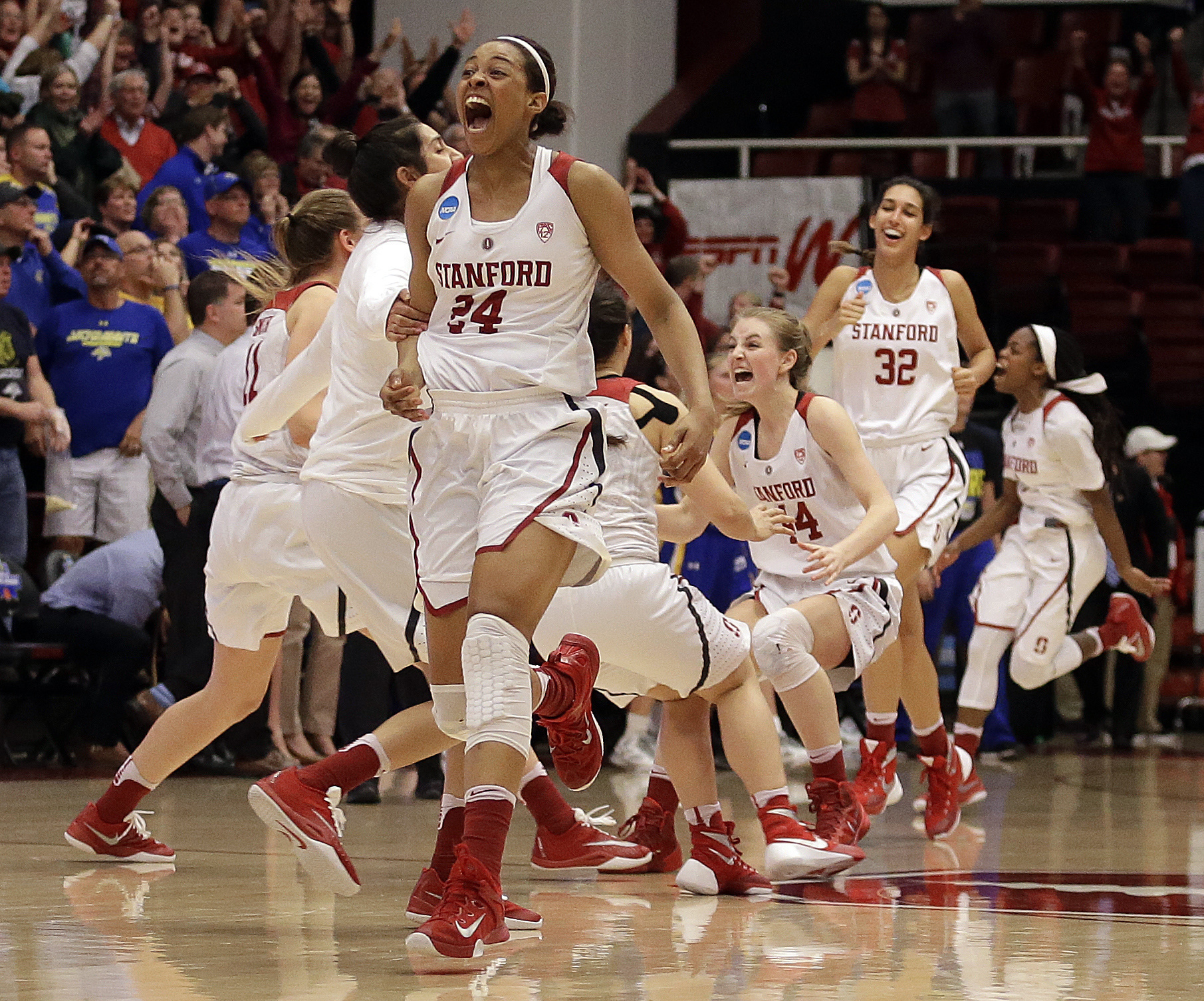FILE - In this March 21, 2016, file photo, Stanford's Erica McCall, left, Karlie Samuelson (44) and Kailee Johnson (32) celebrate the win over South Dakota State at the end of a second-round women's college basketball game in the NCAA Tournament, in Stanf