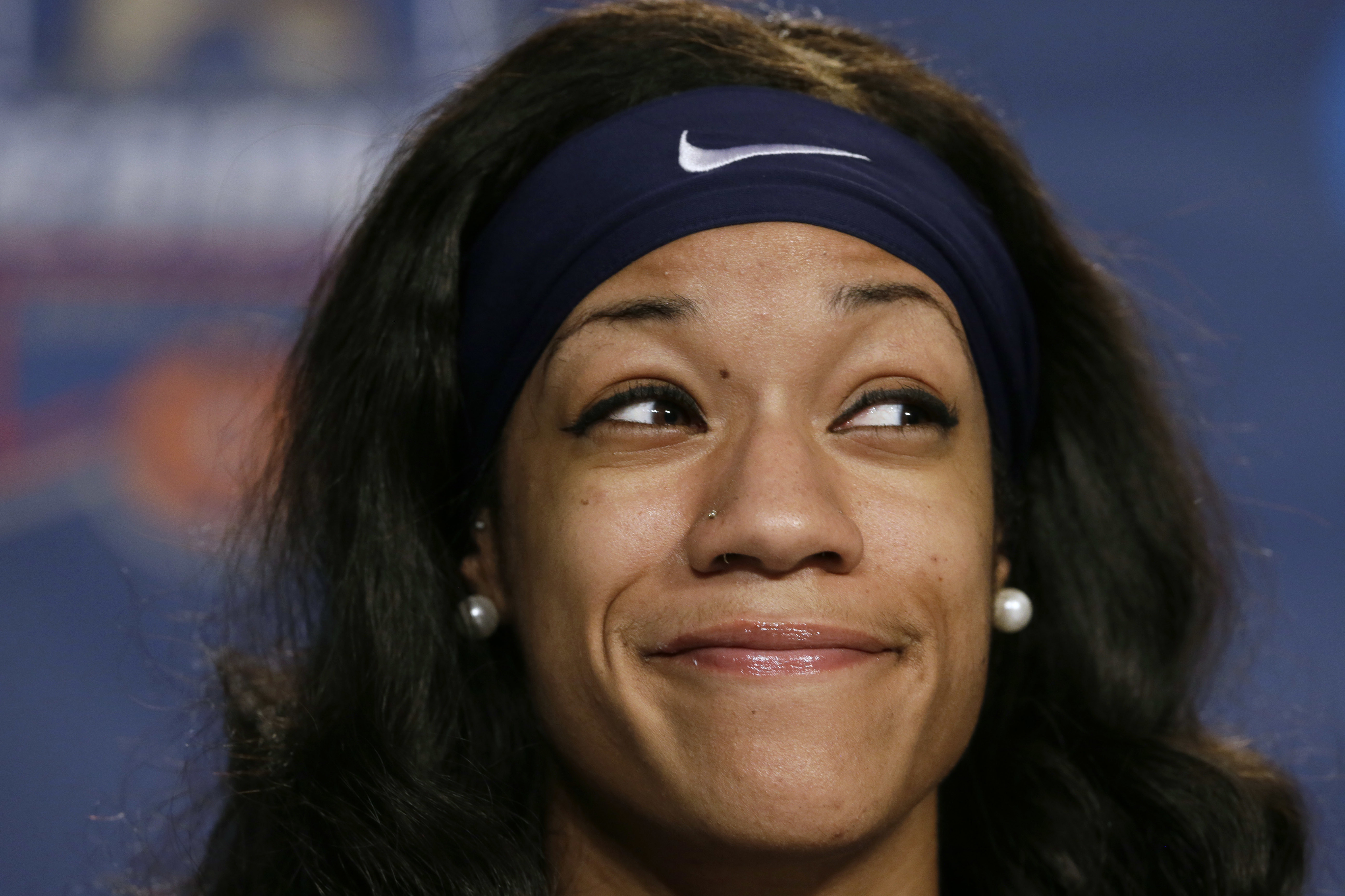 Syracuse center Briana Day smiles during a news conference ahead of a regional semifinal women's college basketball game in the NCAA Tournament, Thursday, March 24, 2016, in Sioux Falls, S.D. Syracuse will play South Carolina on Friday. (AP Photo/Charlie