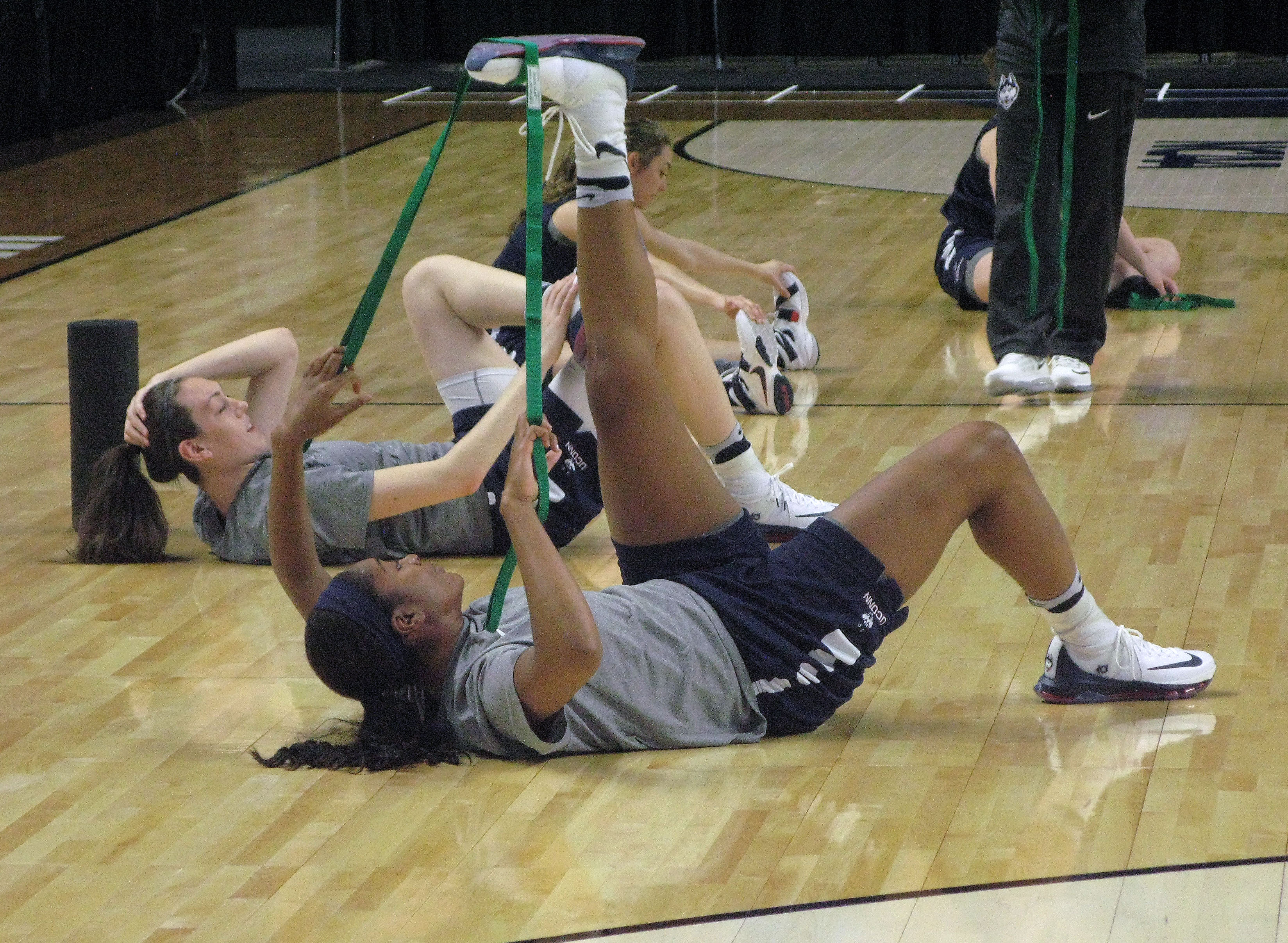 UConn's Morgan Tuck, foreground, and Breanna Stewart stretch during practice for Saturday's NCAA women's college regional semifinal game with Mississippi State at the Webster Bank Arena in Bridgeport, Conn., Friday, March 25, 2016.  The Huskies are making