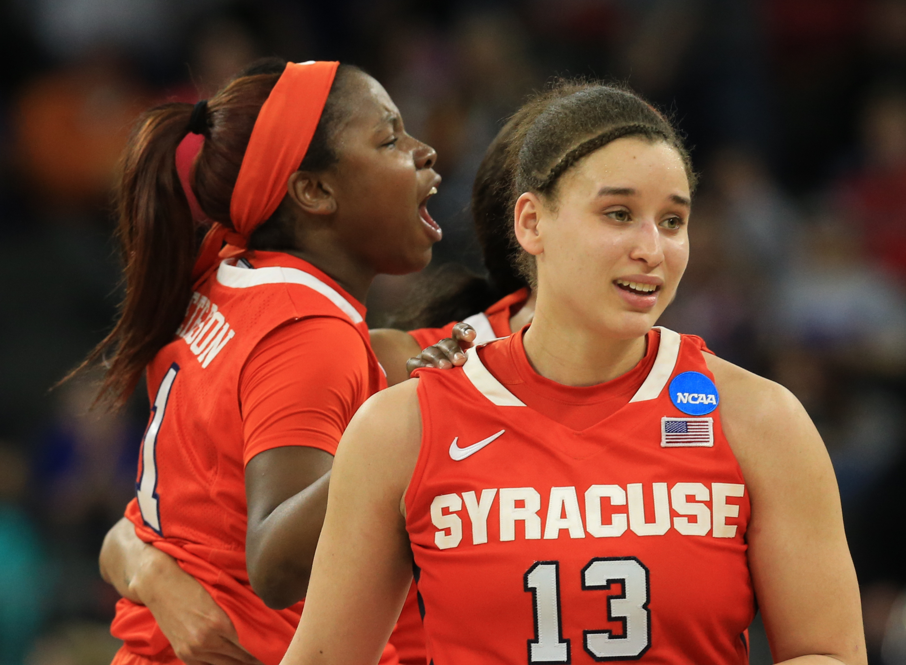 Syracuse's Alexis Peterson (1) and Brianna Butler (13) react following a women's college basketball regional semifinal against South Carolina in the NCAA Tournament in Sioux Falls, S.D., Friday, March 25, 2016. (AP Photo/Nati Harnik)