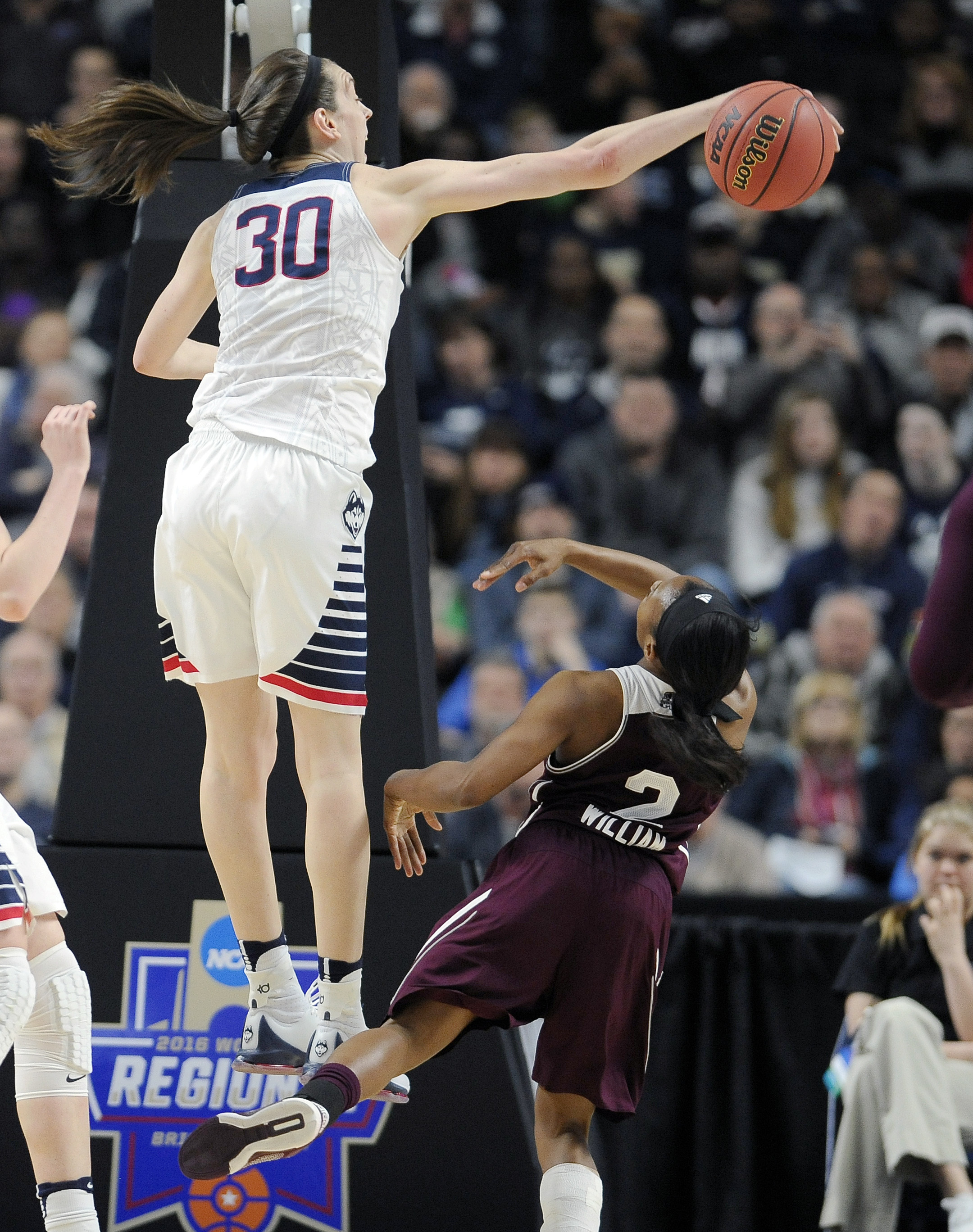 Connecticut's Breanna Stewart, left, blocks a shot by Mississippi State's Morgan William during the first half of an NCAA college basketball game in the regional semifinals of the women's NCAA Tournament, Saturday, March 26, 2016, in Bridgeport, Conn. (AP