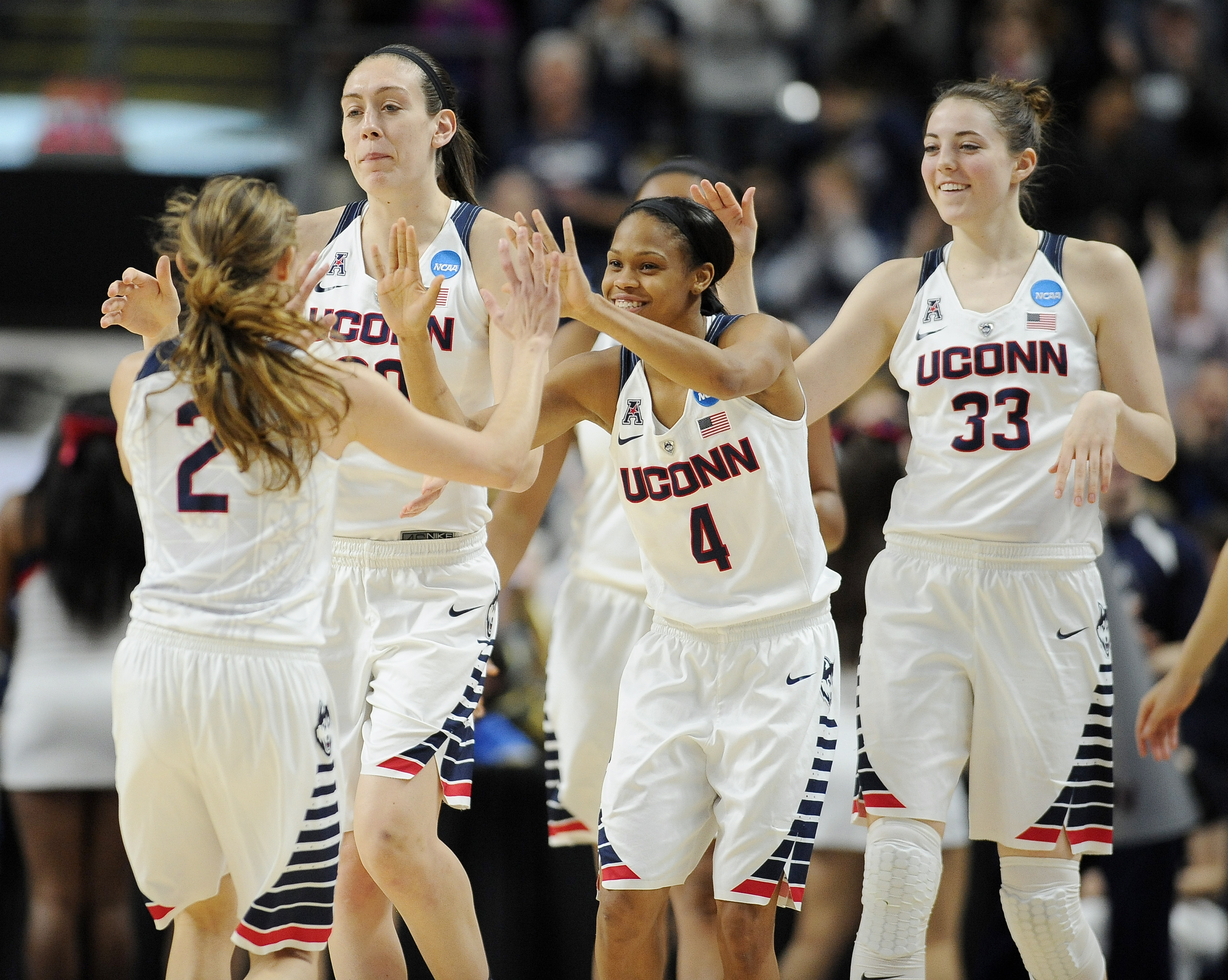 Connecticuts Briana Pulido, left, is greeted by Breanna Stewart, second from left, Moriah Jefferson, center, and Katie Lou Samuelson, right, at the end of an NCAA college basketball game against Mississippi State in the regional semifinals of the women's