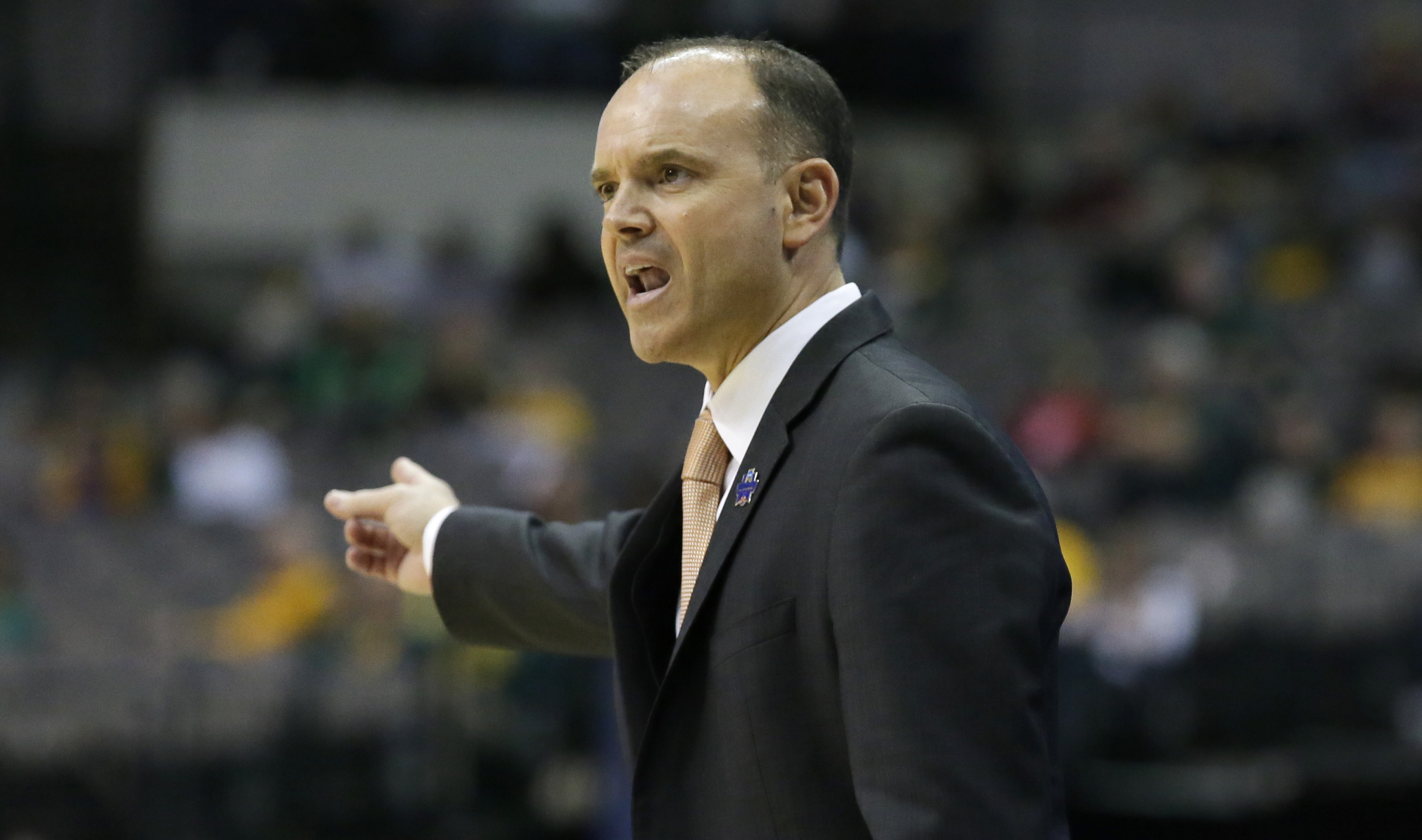 Oregon State head coach Scott Rueck gives directions during the first half of an NCAA college basketball game against DePaul in the regional semifinals of the women's NCAA Tournament Saturday, March 26, 2016, in Dallas. (AP Photo/LM Otero)