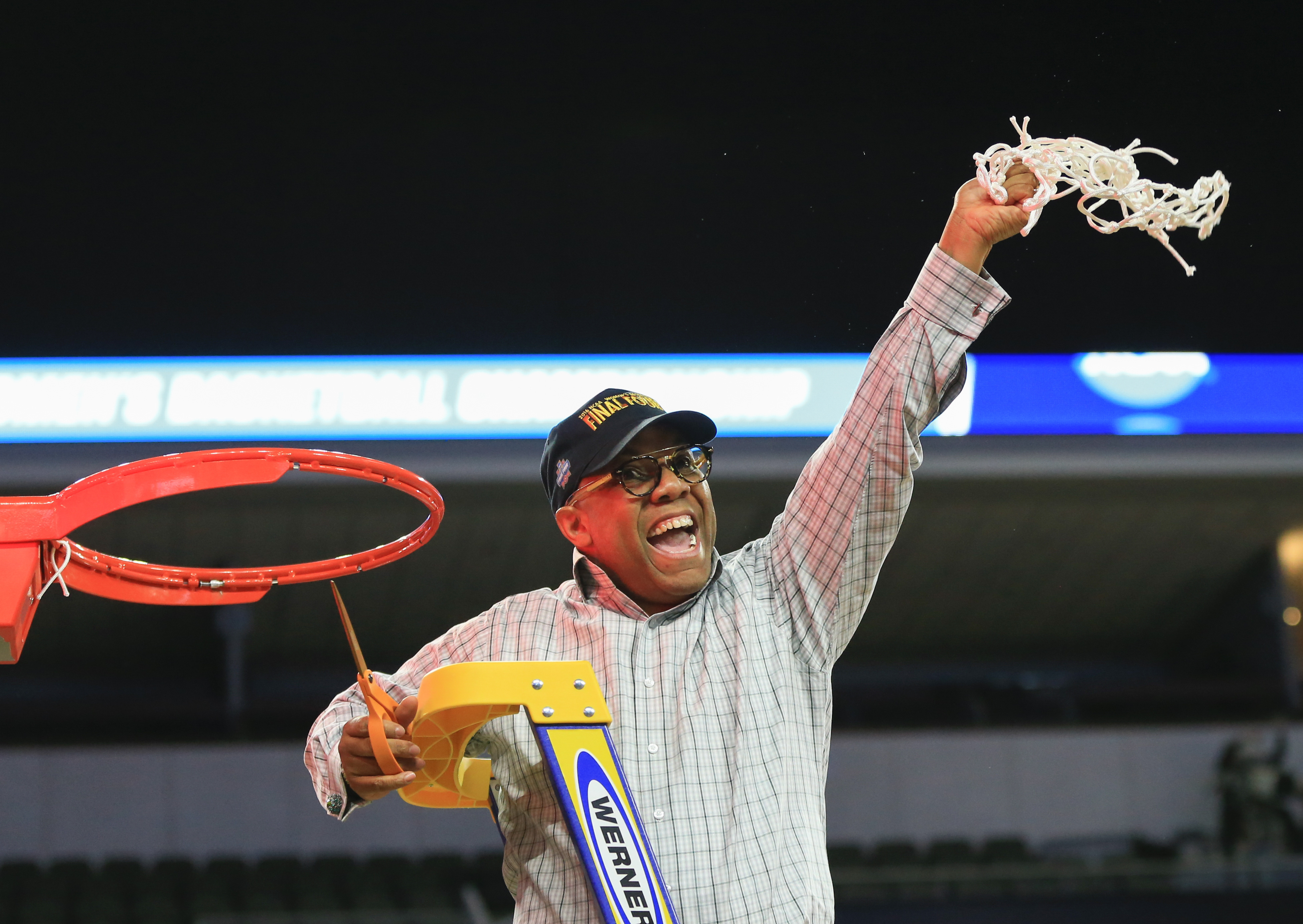 Syracuse coach Quentin Hillsman celebrates as he cuts the net following a women's college basketball regional final against Tennessee in the NCAA Tournament in Sioux Falls, S.D., Sunday, March 27, 2016. Syracuse won 89-67. (AP Photo/Nati Harnik)