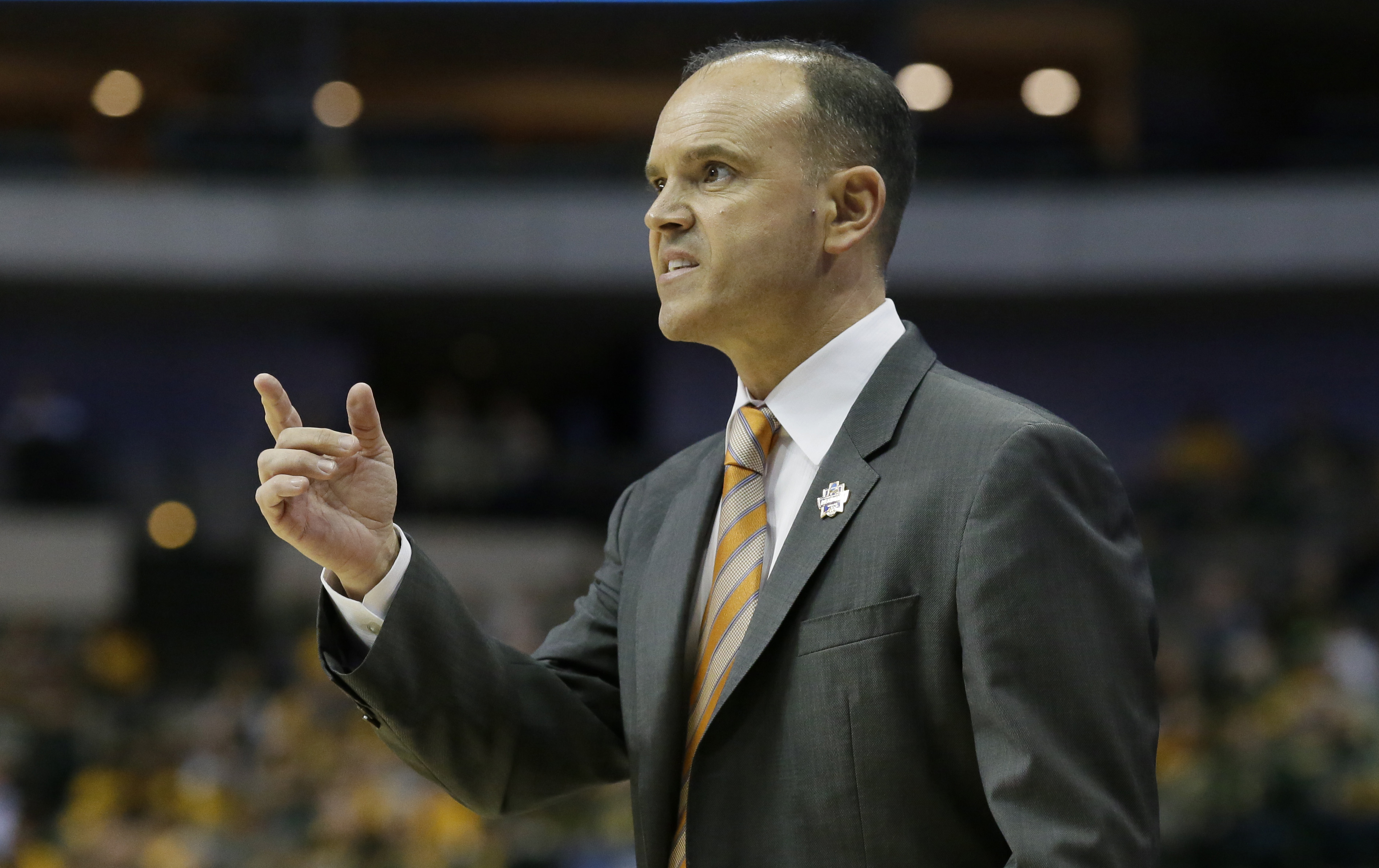 Oregon State head coach Scott Rueck watches from the sideline during the first half of a regional final of the women's NCAA Tournament against Baylor Monday, March 28, 2016, in Dallas. (AP Photo/LM Otero)