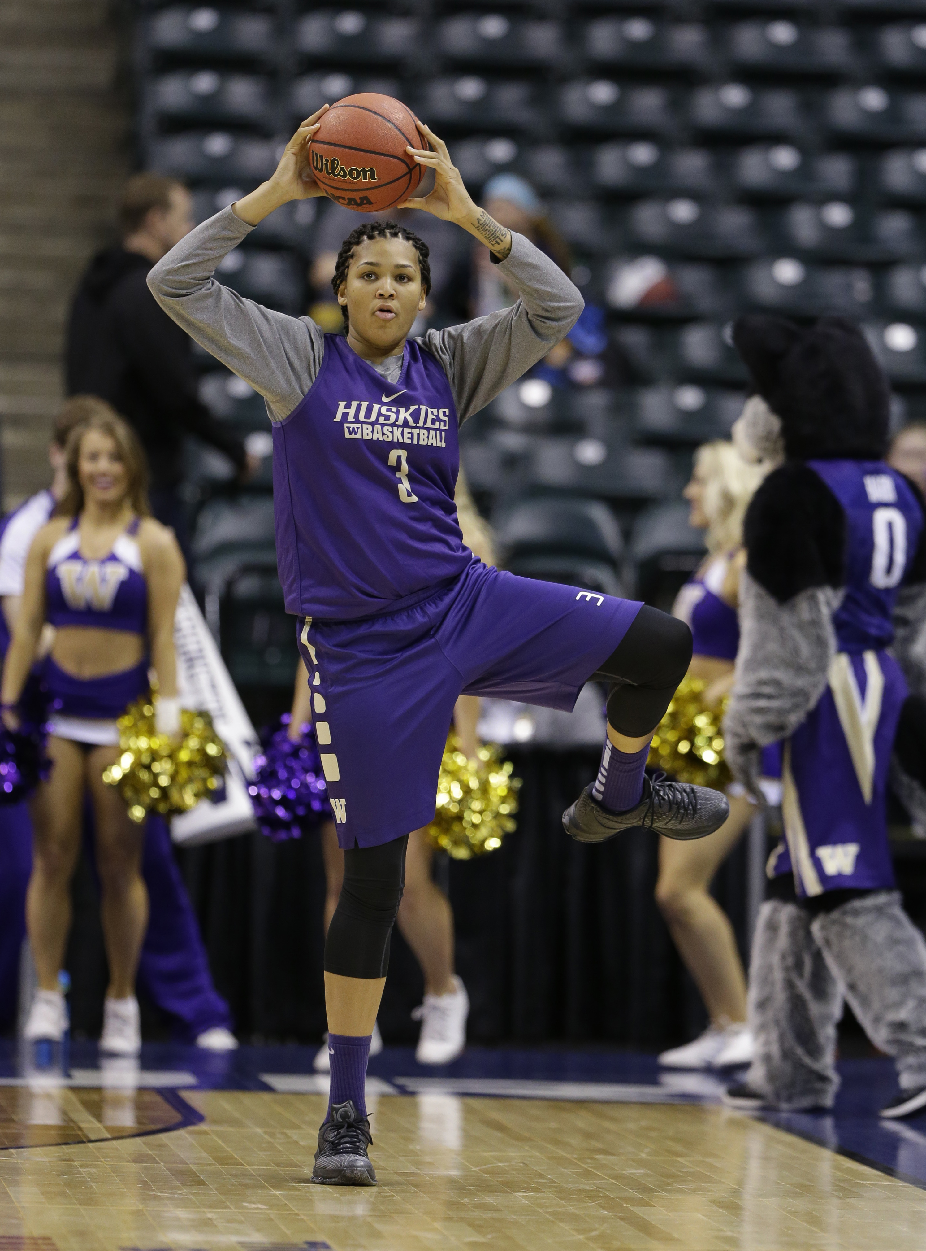 Washington's Talia Walton (3) stretches during college basketball practice for the women's Final Four in the NCAA Tournament Saturday, April 2, 2016, in Indianapolis. (AP Photo/Michael Conroy)