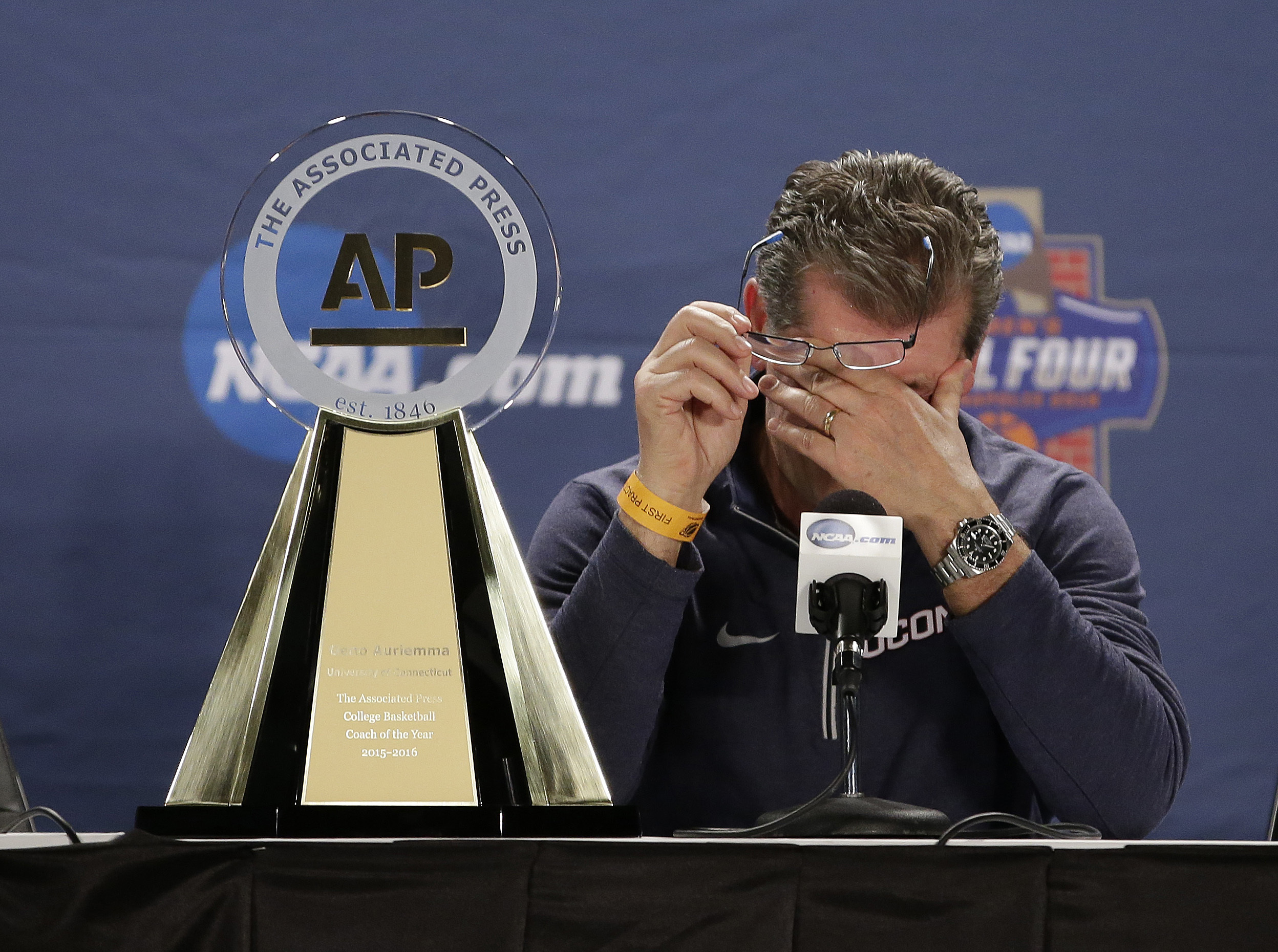 Connecticut head coach Geno Auriemma wipes his eye after being named the Associated Press Coach of the Year during a news conference at the women's Final Four in the NCAA Tournament Saturday, April 2, 2016, in Indianapolis. (AP Photo/AJ Mast)