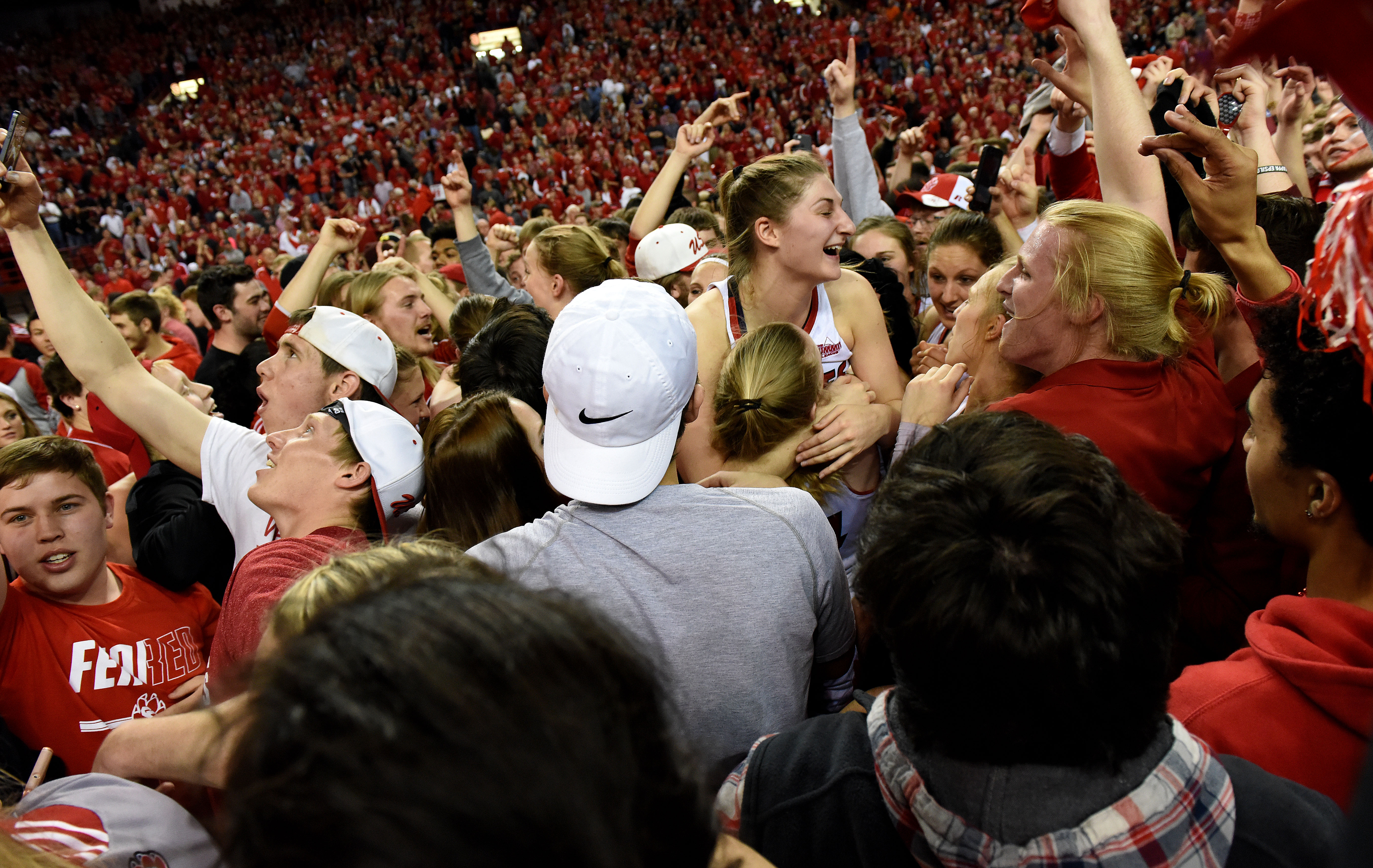 South Dakota fans storm the court after their team defeated Florida Gulf Coast 71-65 in the WNIT championship women's college basketball game at the DakotaDome in Vermillion, S.D., Saturday, April 2, 2016.  (Emily Spartz Weerheim/The Argus Leader via AP)
