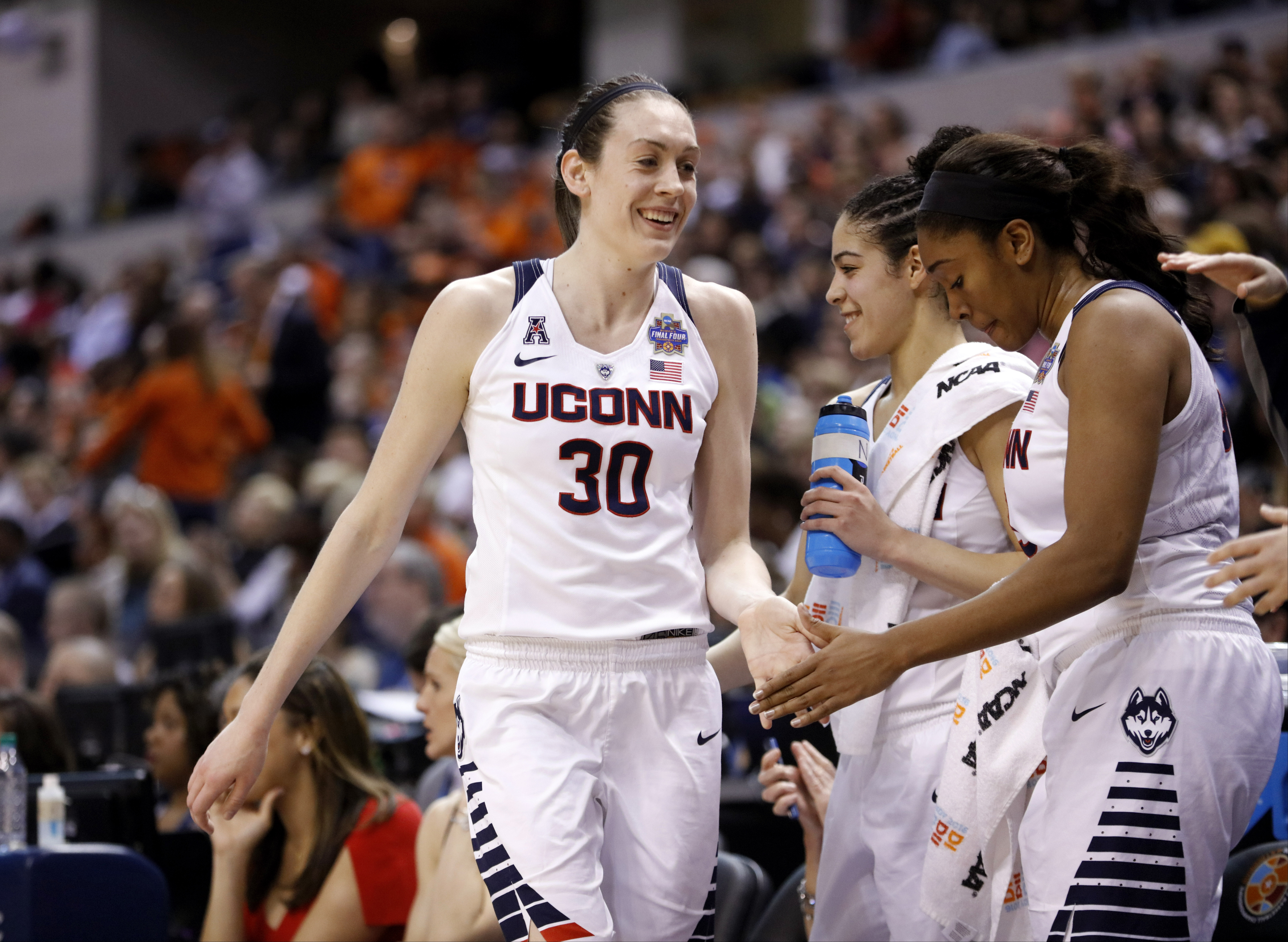 Connecticut's Breanna Stewart (30) comes out of the game late in the second half of a national semifinal game against Oregon State, at the women's Final Four in the NCAA college basketball tournament Sunday, April 3, 2016, in Indianapolis. Connecticut won