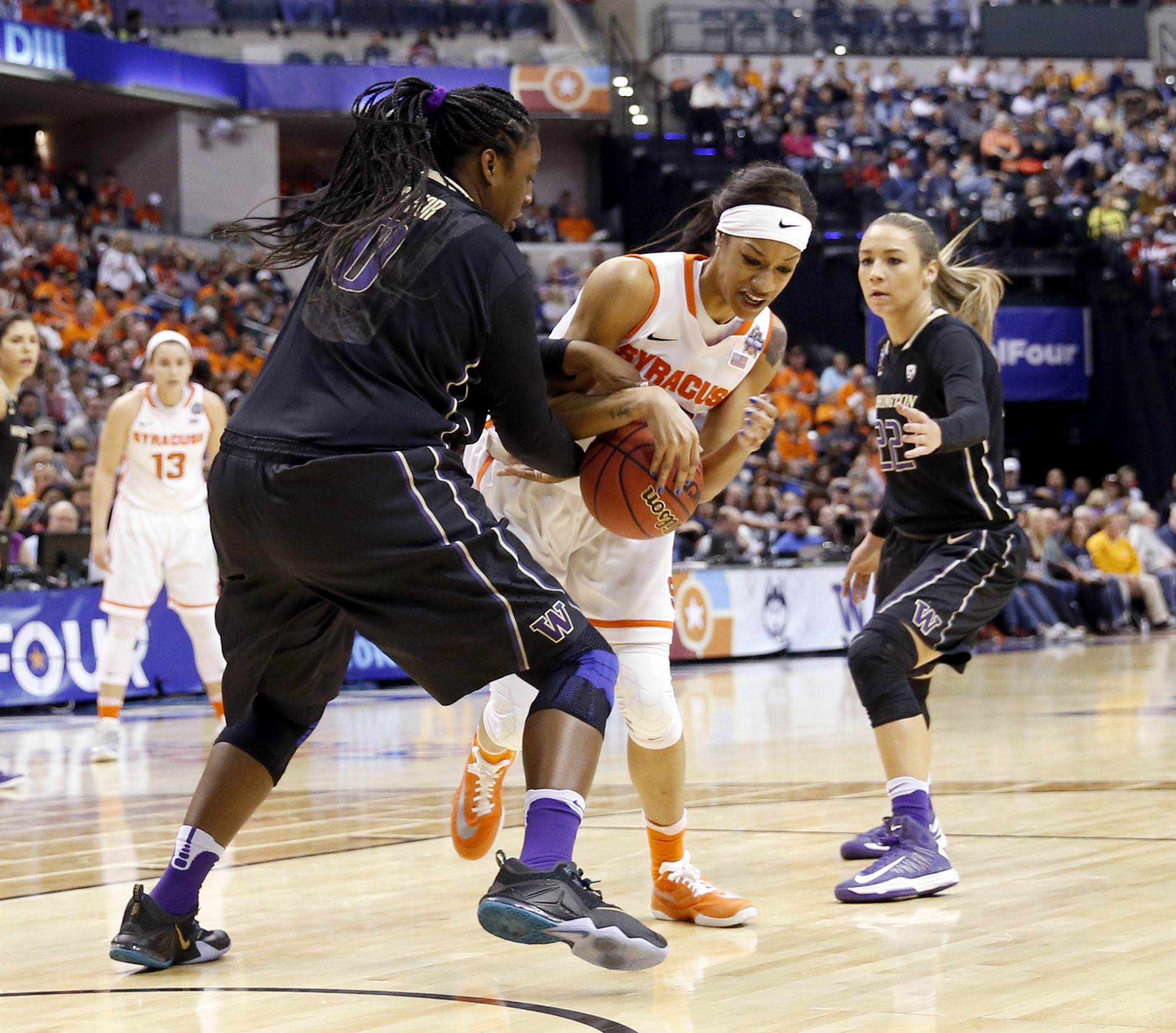Washington's Chantel Osahor (0) and Syracuse's Briana Day (50) grab a loose ball during the first half of a national semifinal game at the women's Final Four in the NCAA college basketball tournament Sunday, April 3, 2016, in Indianapolis. (AP Photo/AJ Ma
