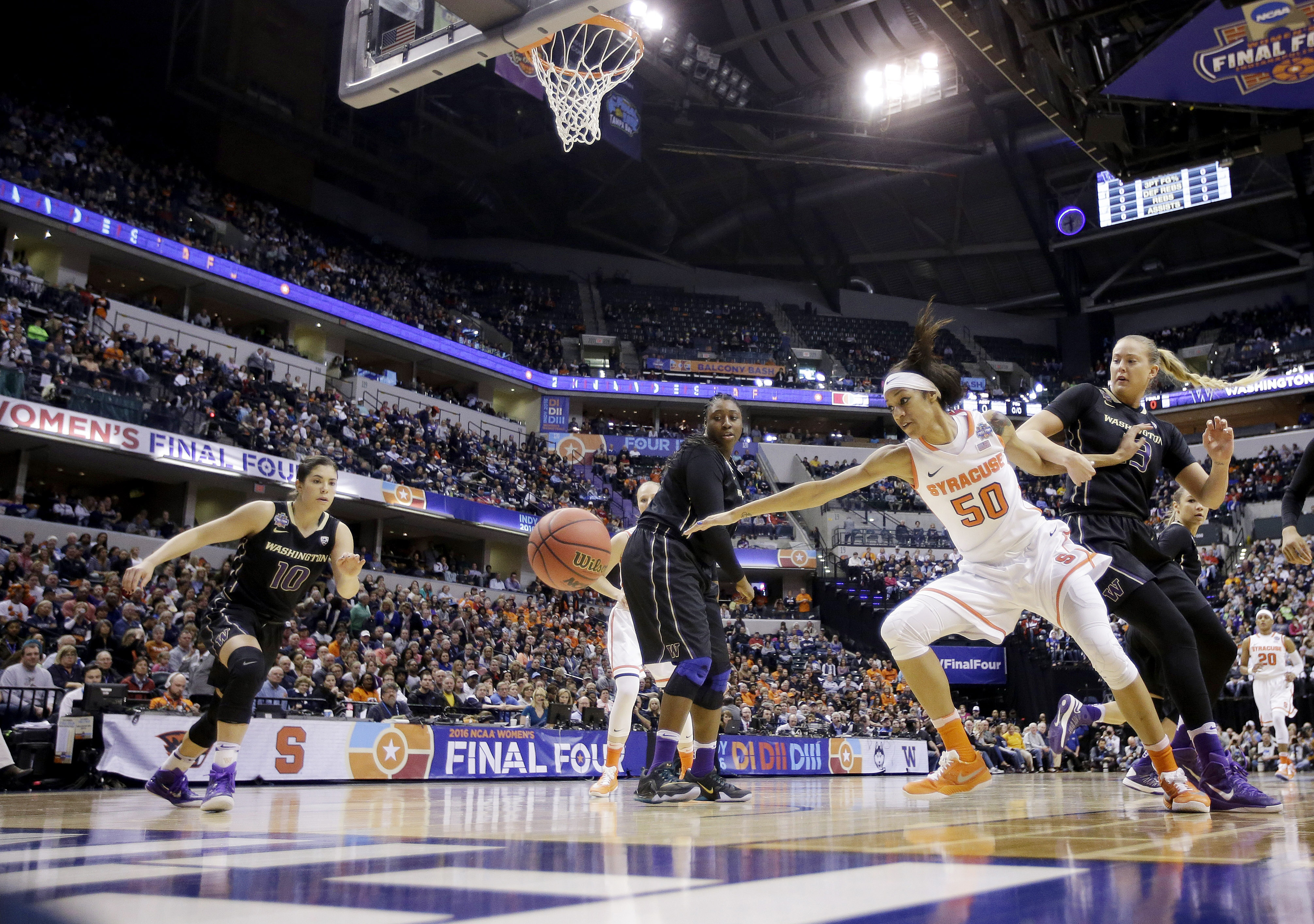 Syracuse's Briana Day (50) goes for a loose ball against Washington's Katie Collier (13) as Kelsey Plum (10) moves in during the first half of a national semifinal game at the women's Final Four in the NCAA college basketball tournament Sunday, April 3, 2