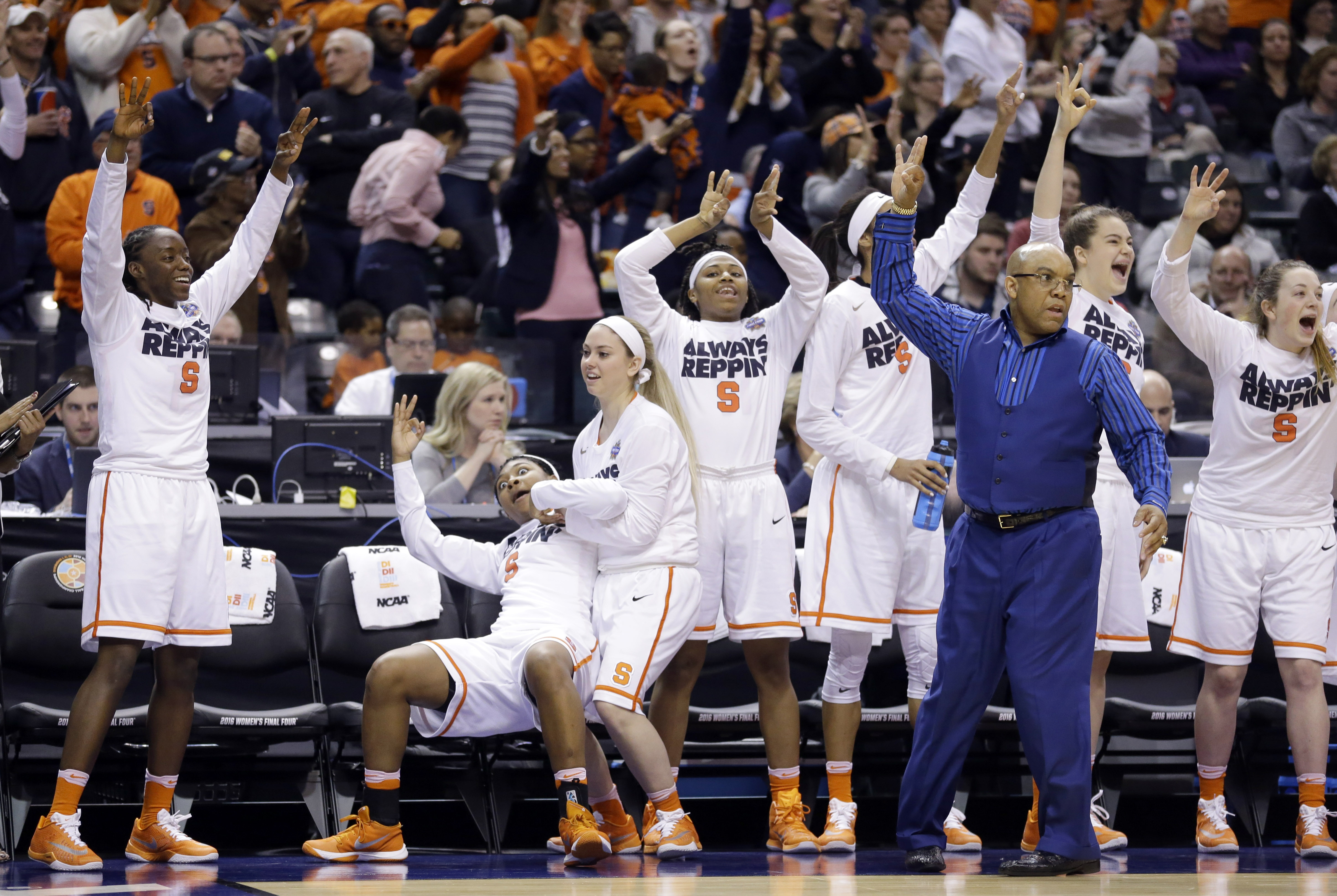 Syracuse head coach Quentin Hillsman and players react after a three-point basket during the first half of a national semifinal game against Washington, at the women's Final Four in the NCAA college basketball tournament Sunday, April 3, 2016, in Indianap