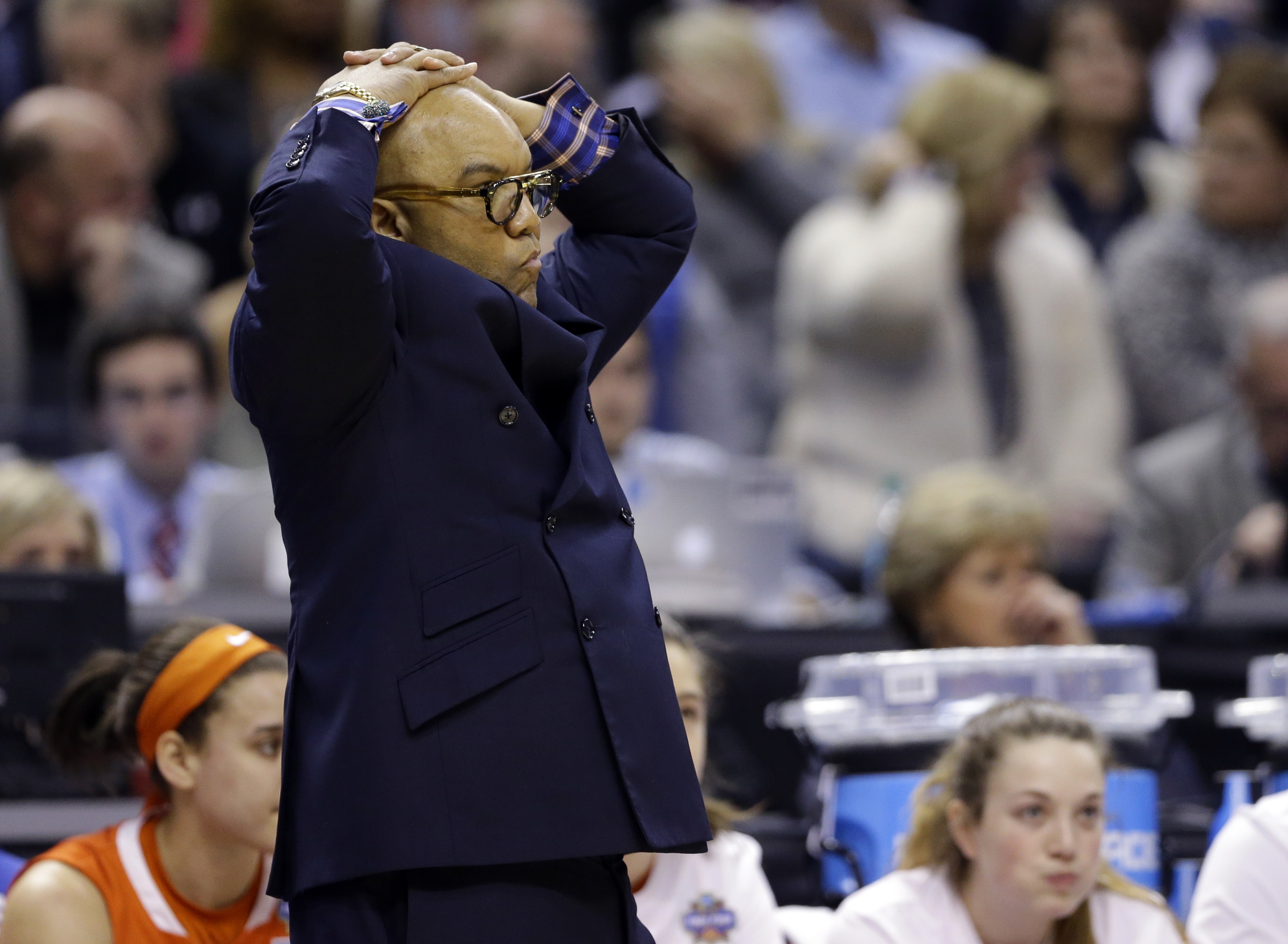 Syracuse head coach Quentin Hillsman watches during the first half of the championship game against Connecticut, at the women's Final Four in the NCAA college basketball tournament Tuesday, April 5, 2016, in Indianapolis. (AP Photo/Michael Conroy)