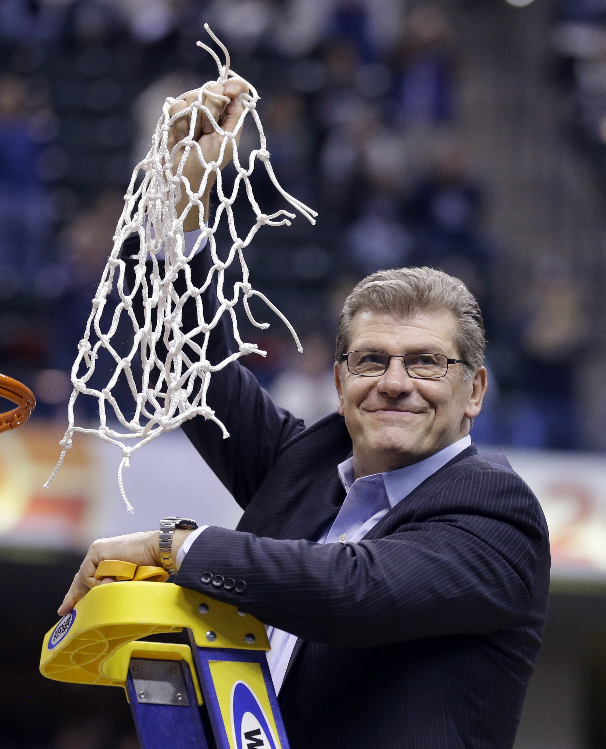 Connecticut head coach Geno Auriemmac celebrates by cutting down the net following the championship game against Syracuse at the women's Final Four in the NCAA college basketball tournament Tuesday, April 5, 2016, in Indianapolis. Connecticut won 82-51. (