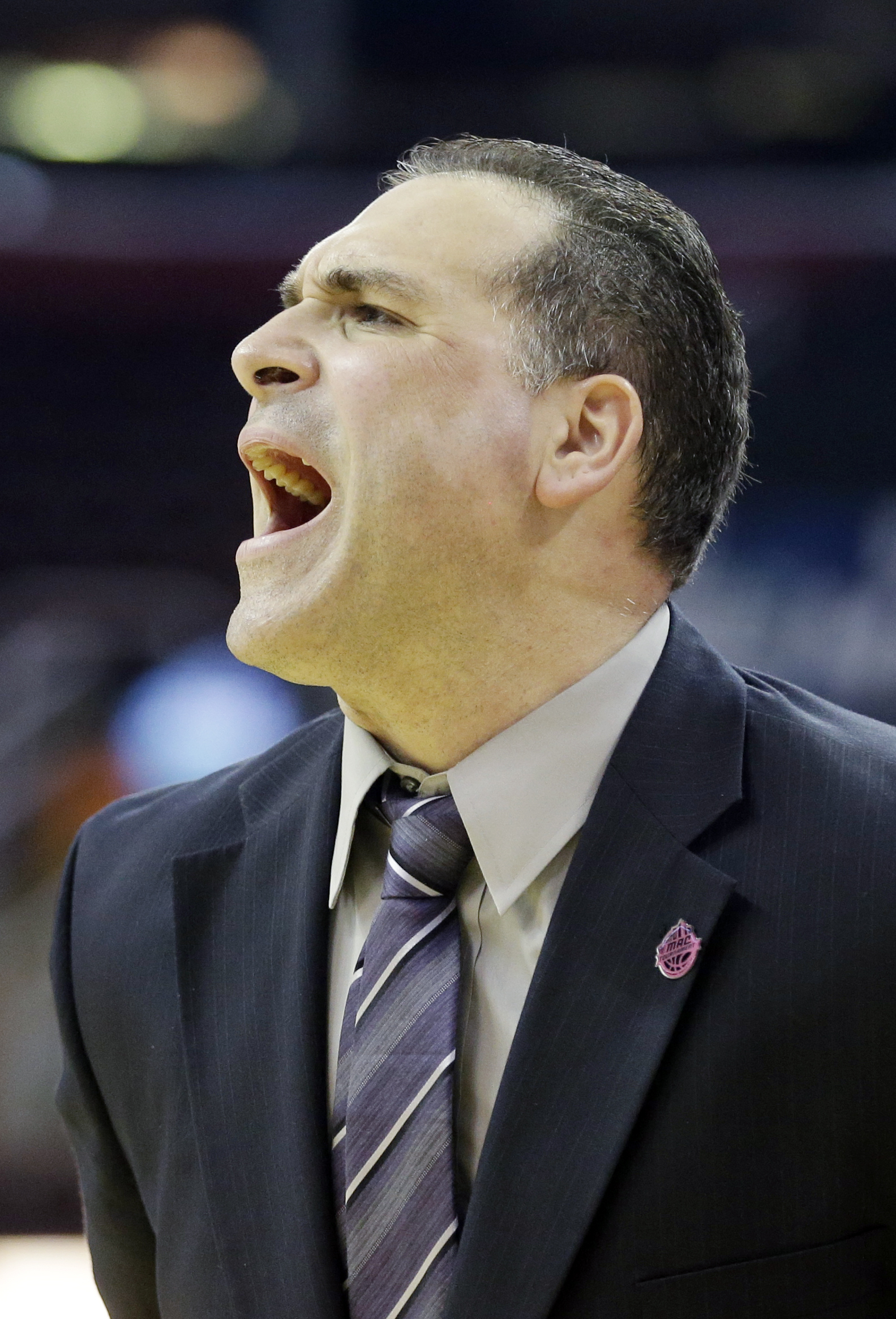Eastern Michigan head coach Tory Verdi yells at his team during the first half of an NCAA college basketball game against Ohio in the championship of the Mid-American Conference tournament Saturday, March 14, 2015, in Cleveland. (AP Photo/Mark Duncan)