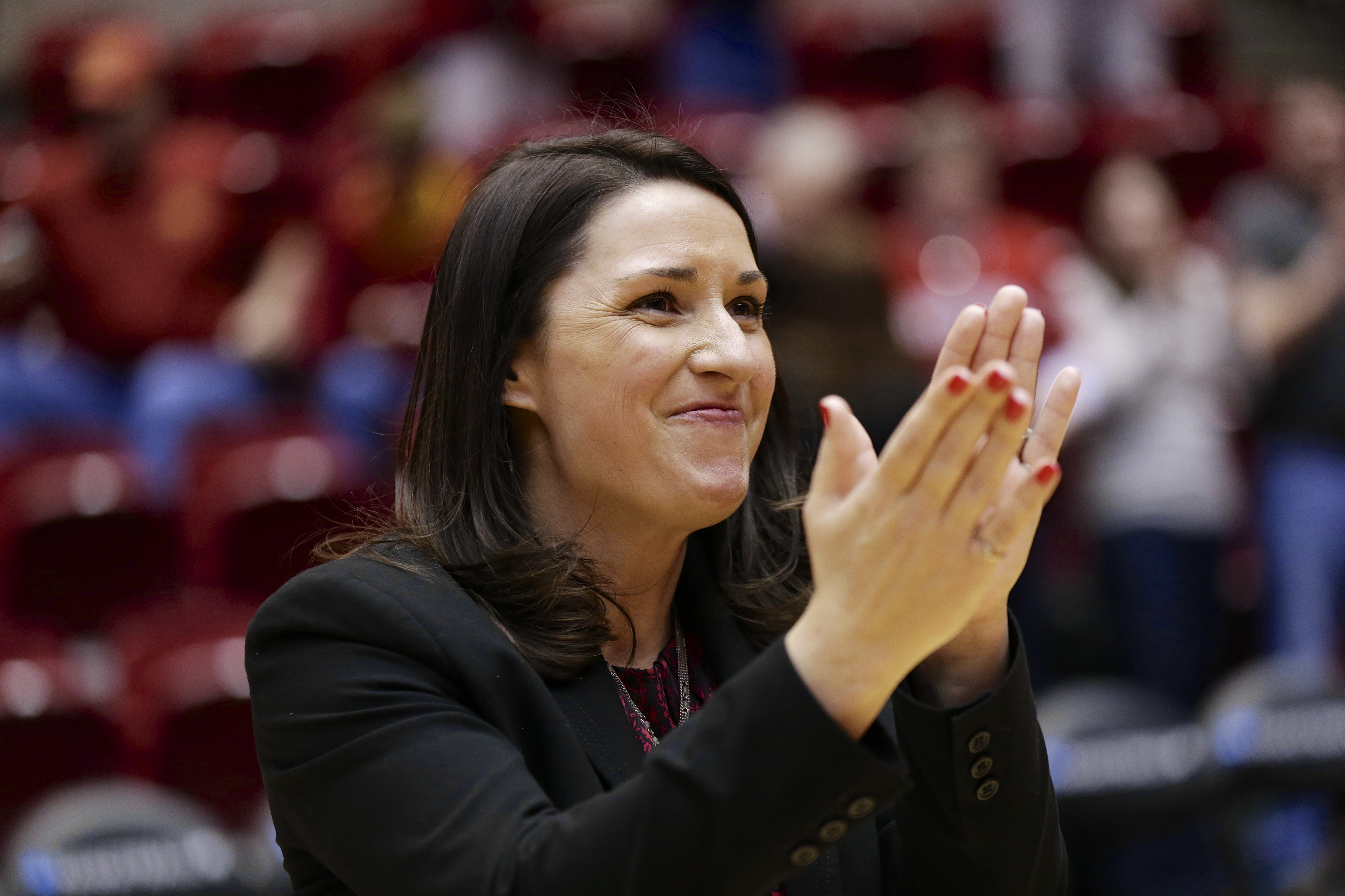 South Dakota coach Amy Williams applauds fans following a first-round game against against Stanford in the NCAA women's college basketball tournament in Ames, Iowa, Saturday, March 22, 2014. Stanford won 81-62. (AP Photo/Nati Harnik)