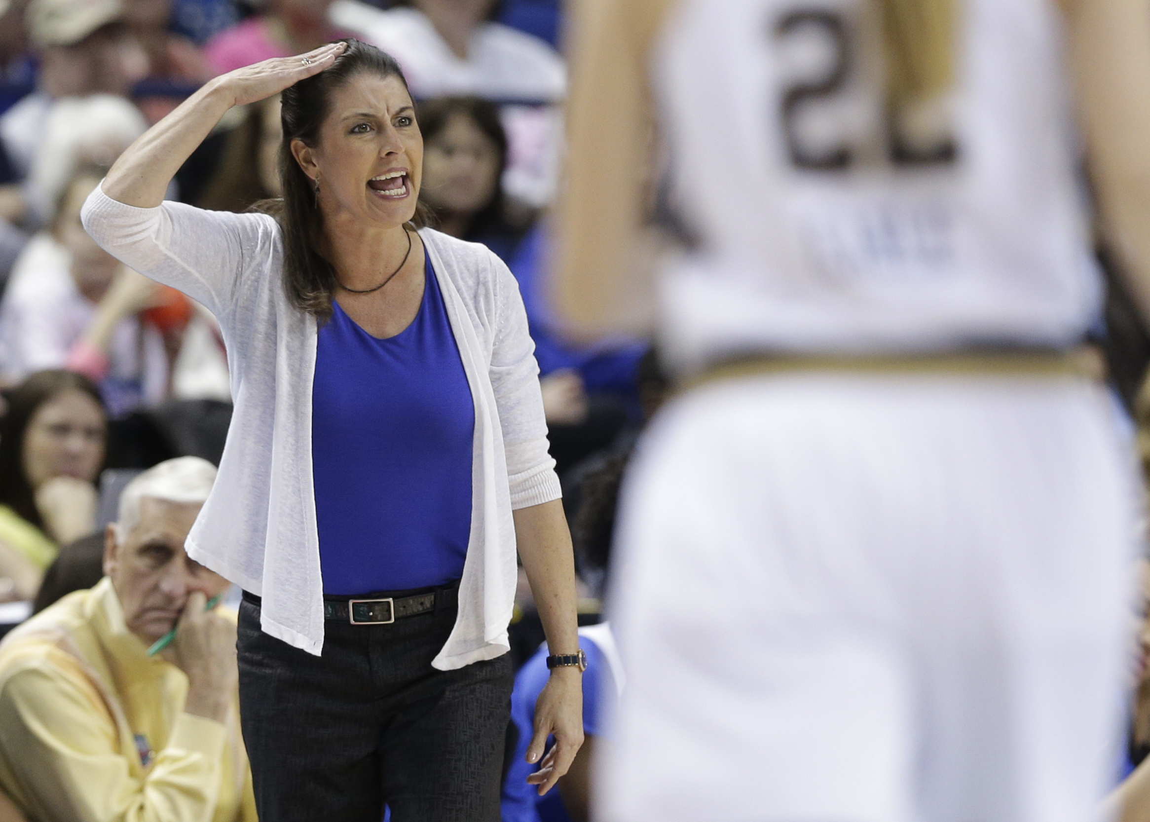 Duke head coach Joanne P. McCallie directs her team against Notre Dame during the first half of an NCAA college basketball game in the Atlantic Coast Conference tournament in Greensboro, N.C., Friday, March 4, 2016. (AP Photo/Chuck Burton)