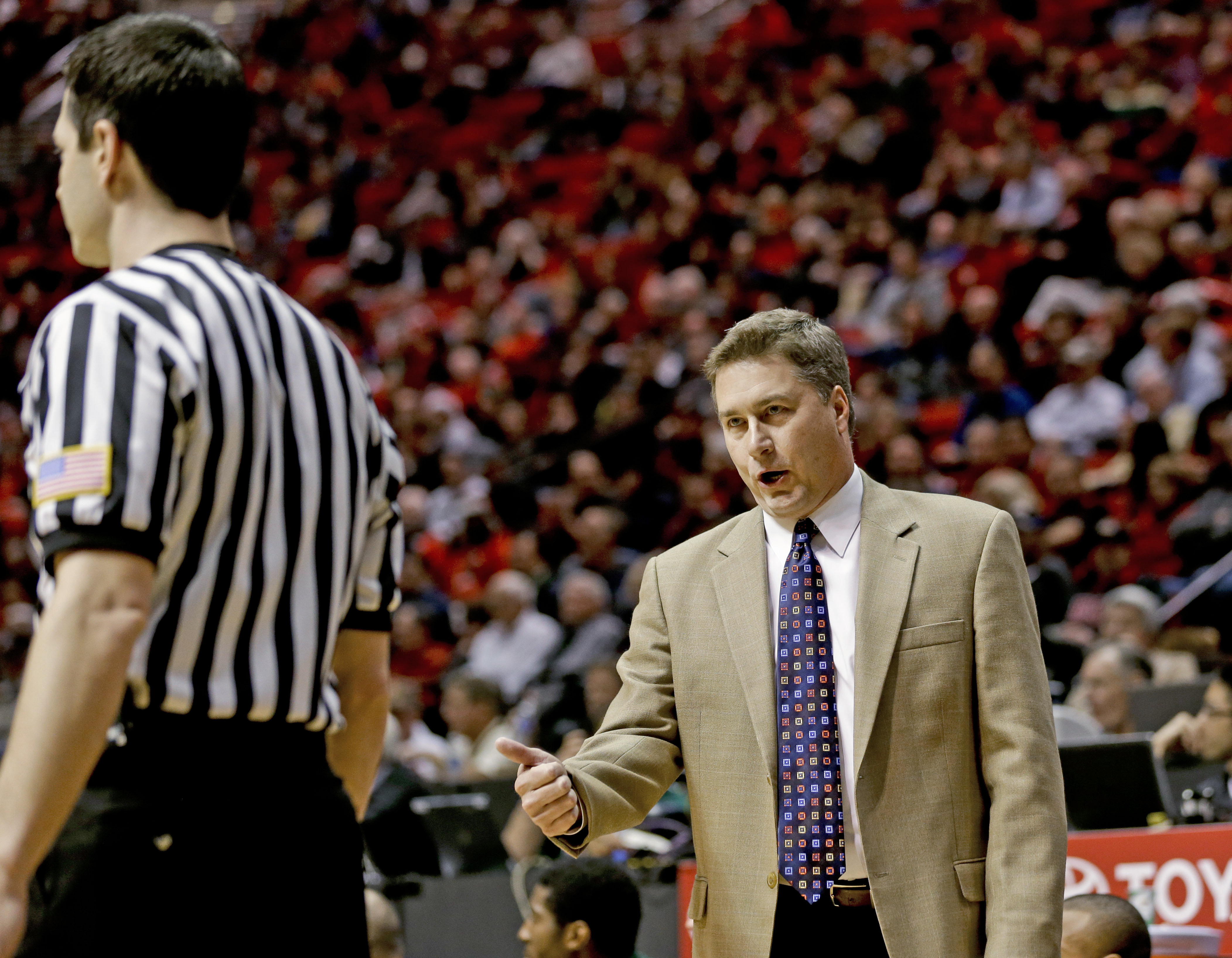 Point Loma Nazarene coach Bill Carr has words for an official being assessed a technical foul during the first half of an NCAA college basketball game against San Diego State on Tuesday, Dec. 18, 2012, in San Diego. (AP Photo/Lenny Ignelzi)