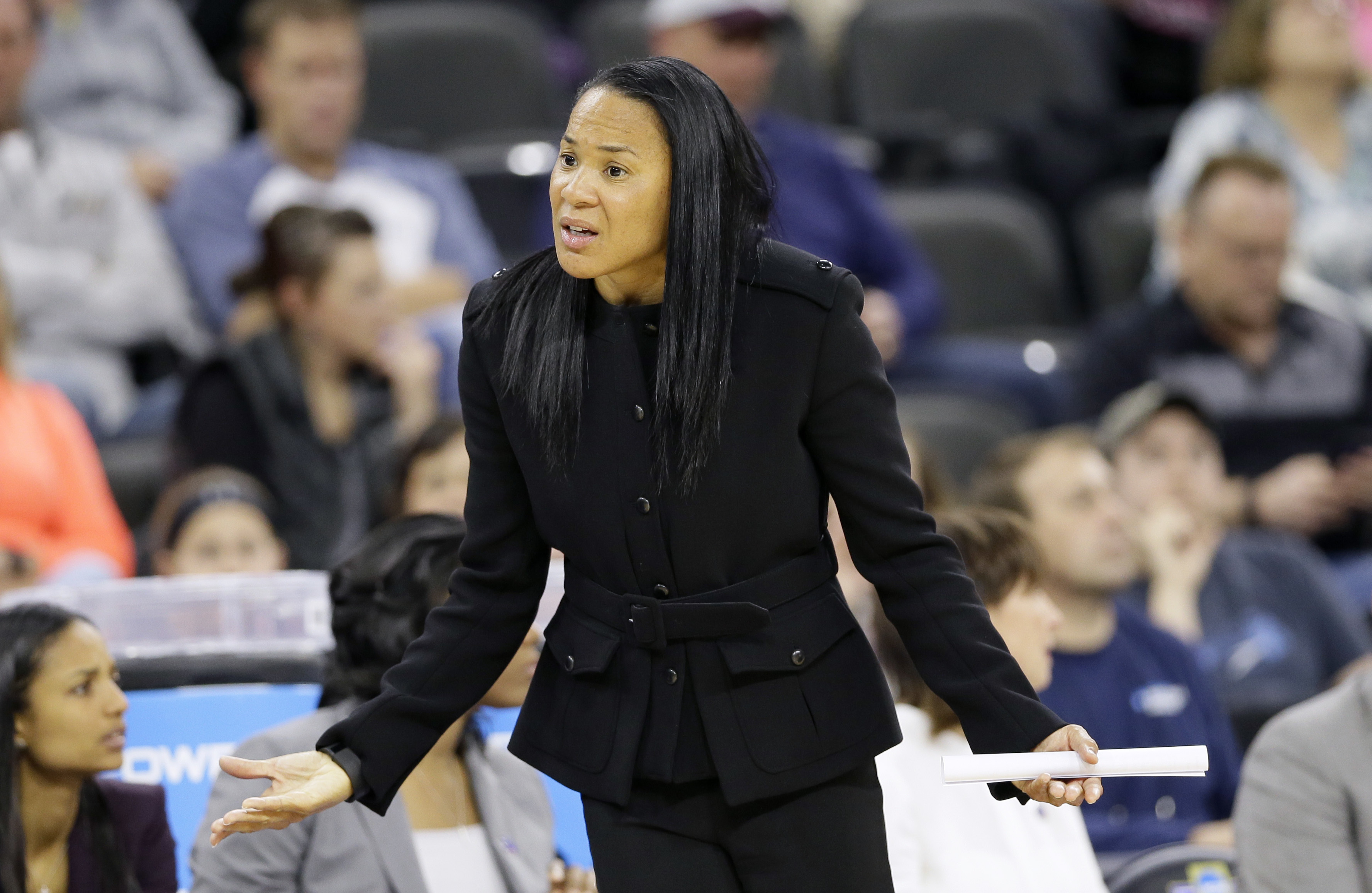 FILE - In this March 25, 2016 file photo, South Carolina head coach Dawn Staley reacts to a call during the first half of a regional semifinal women's college basketball game against Syracuse in the NCAA Tournament, in Sioux Falls, S.D. Dawn Staley said S