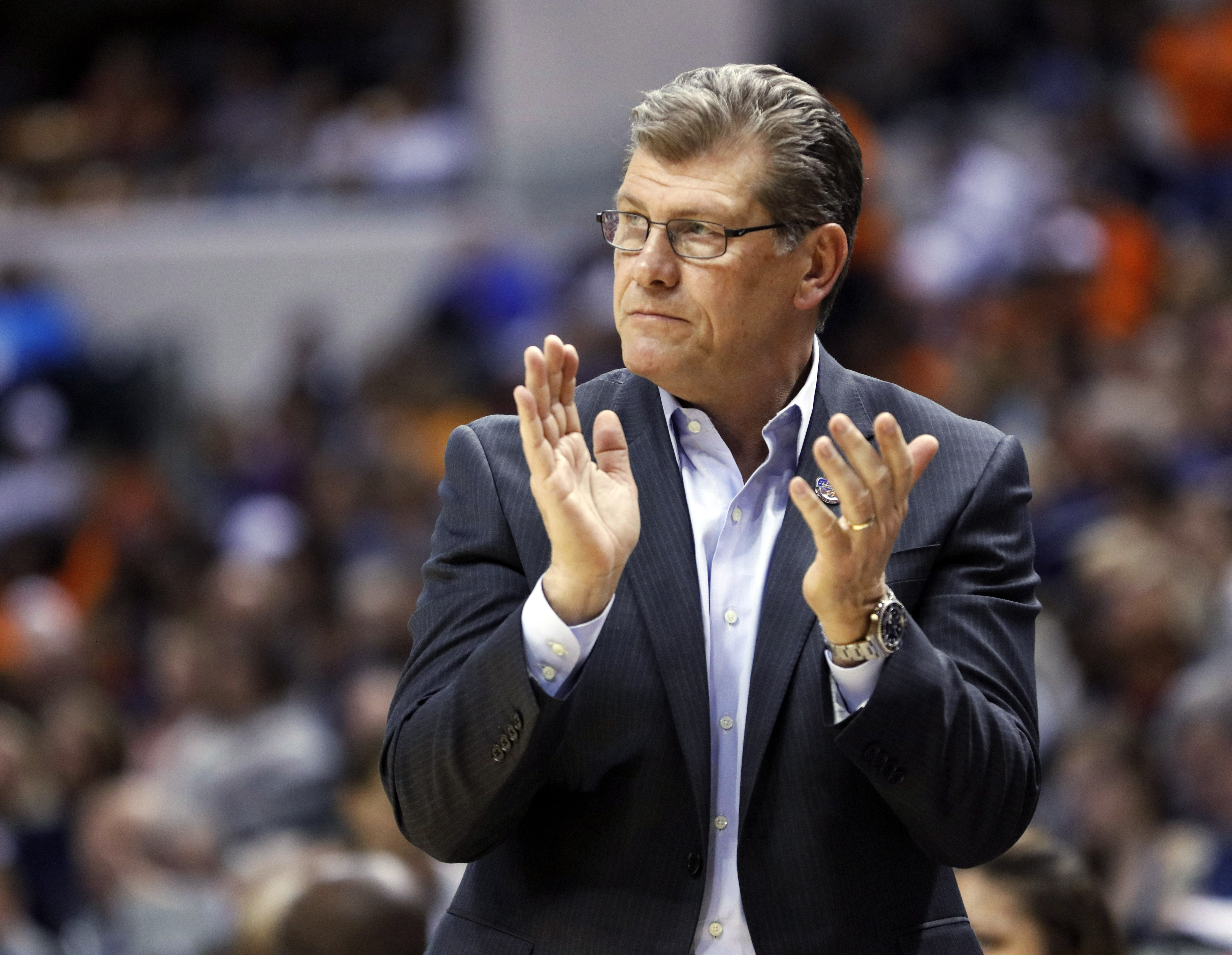 FILE - In this April 3, 2016, file photo, Connecticut coach Geno Auriemma cheers for his team during the second half of a semifinal against Oregon State, at the women's Final Four in the NCAA college basketball tournament in Indianapolis. Auriemma spent a