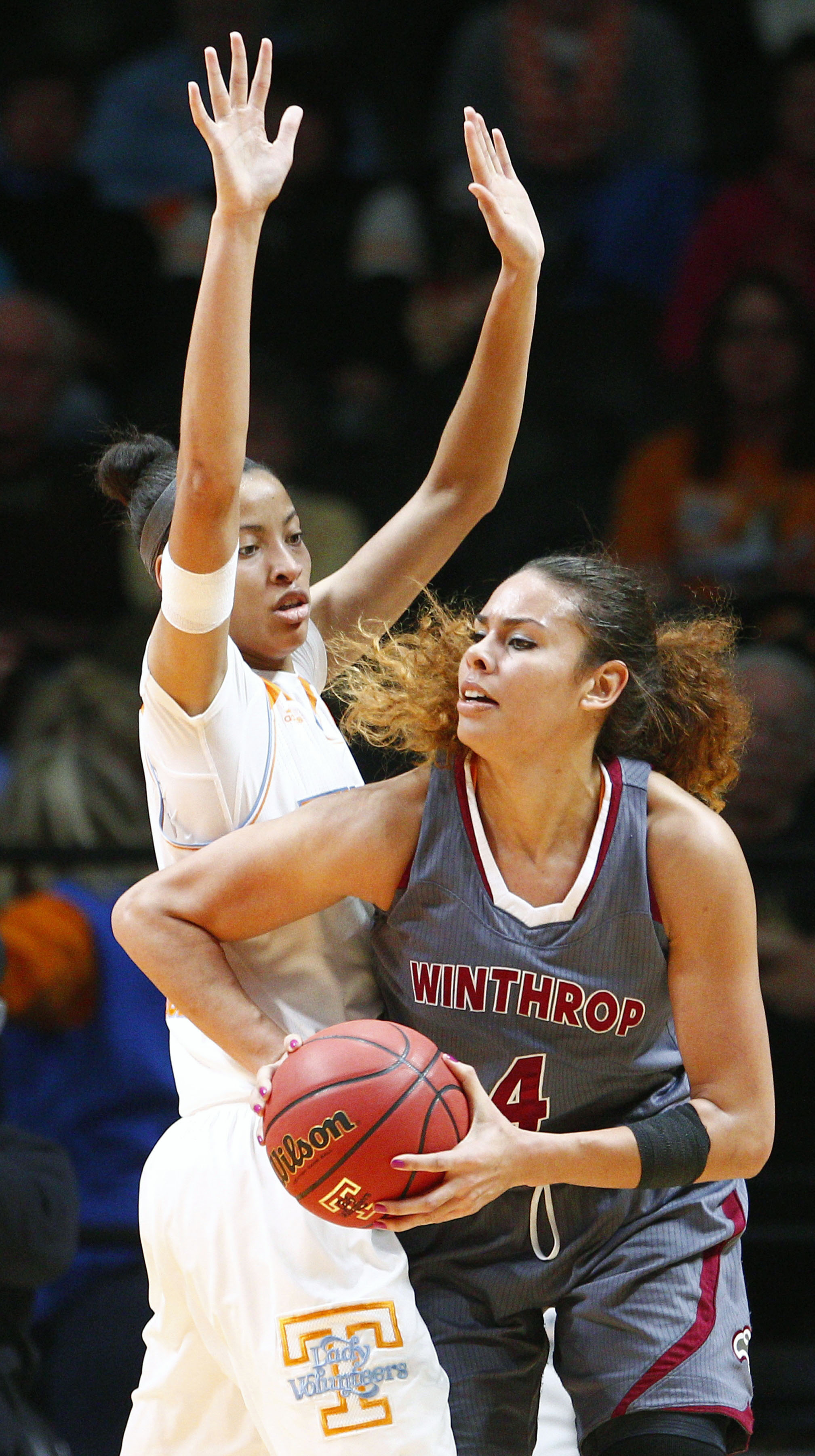 Winthrop center Schaquilla Nunn (4) works for a shot as she's defended by Tennessee center Nia Moore (1) in the second half of an NCAA college basketball game Friday, Nov. 21, 2014, in Knoxville, Tenn. Tennessee won 81-48. (AP Photo/Wade Payne)