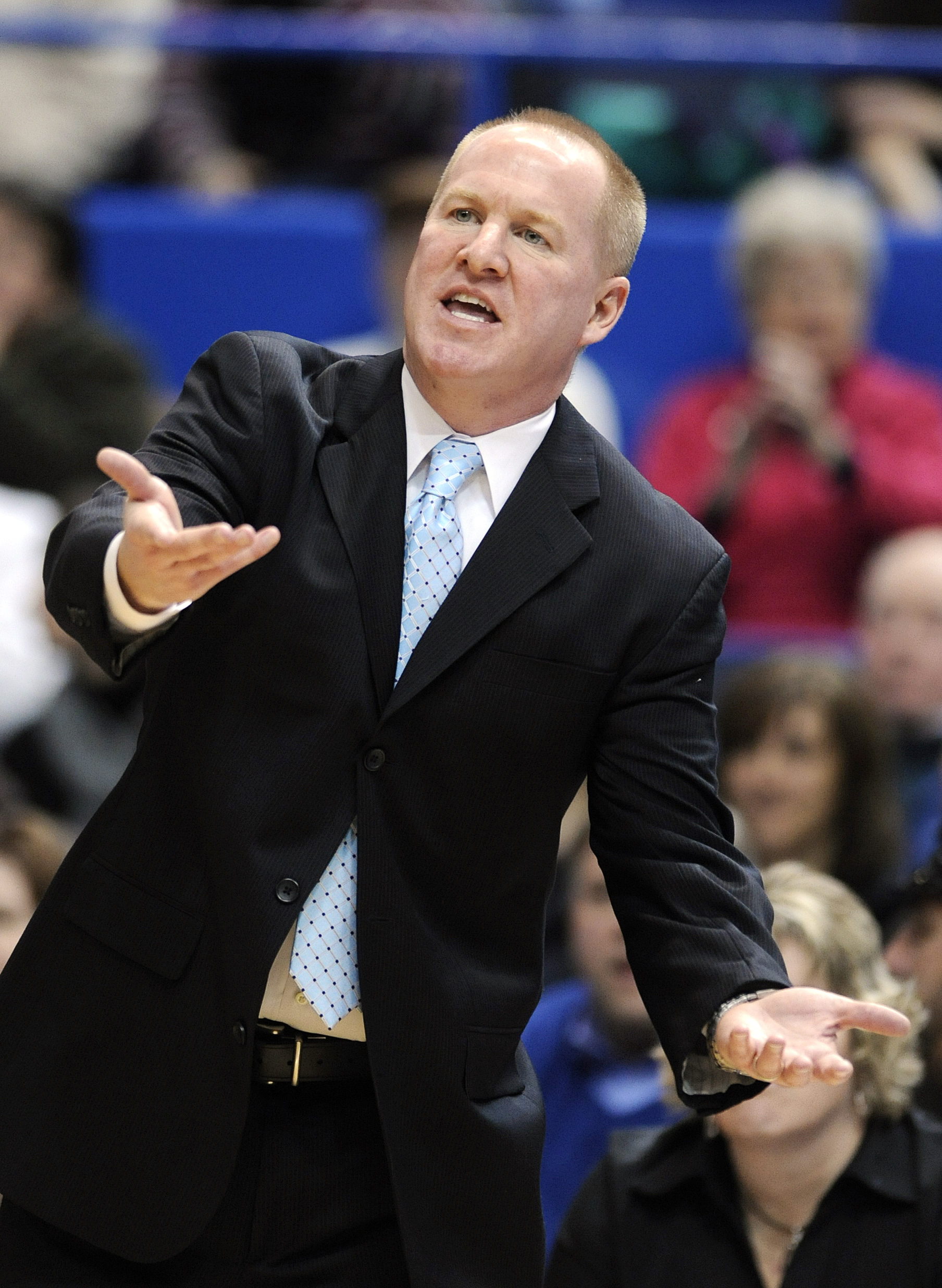 St. Bonaventure coach Jim Crowley gestures during the first half of his team's 88-39 loss to Connecticut in an NCAA college basketball game in Hartford, Conn., on Sunday, Nov. 24, 2013. (AP Photo/Fred Beckham)