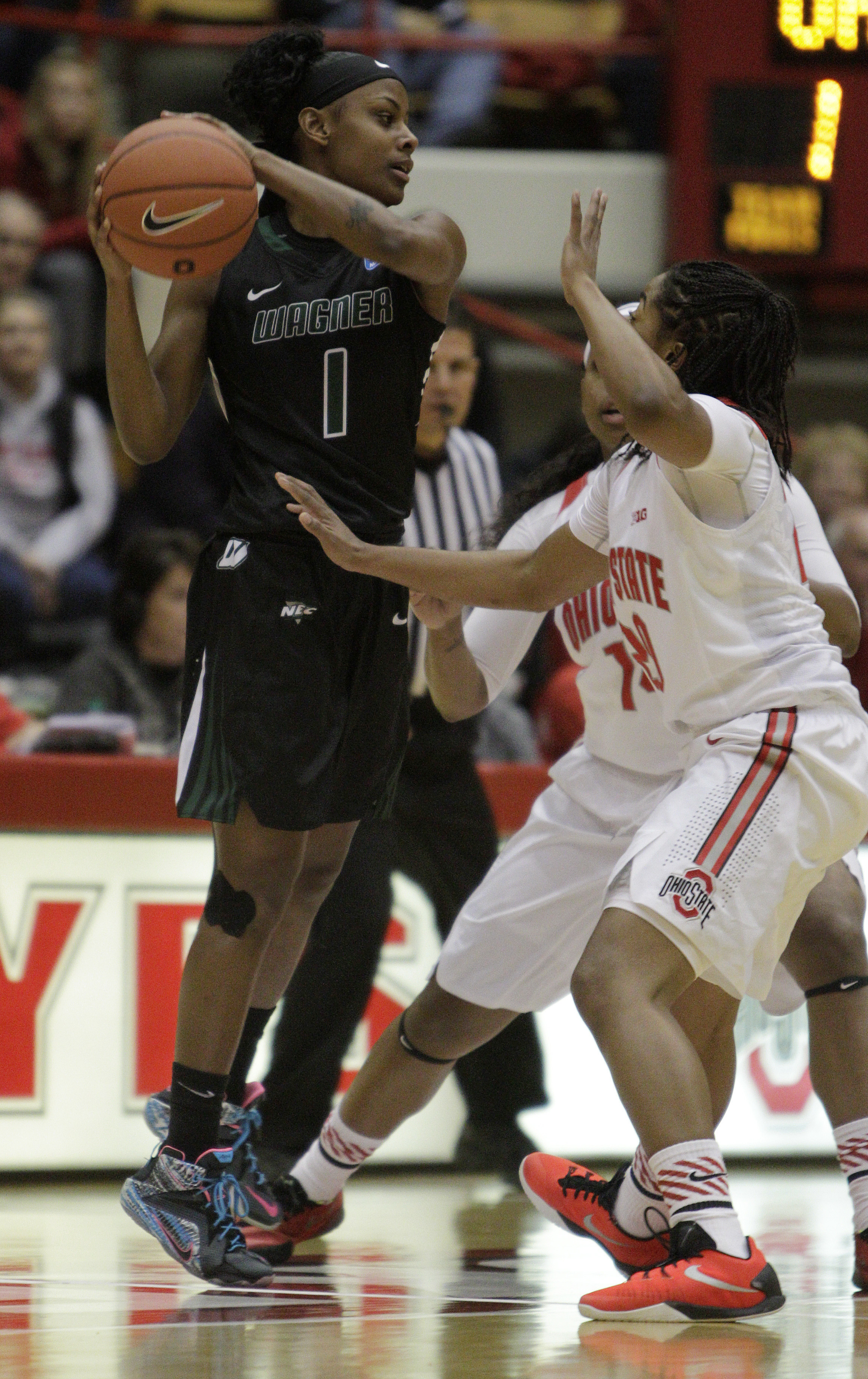 Wagner's Jasmine Nwajei, left, looks for an open pass as Ohio State's Ameryst Alston, center, and Asia Doss defend during the first quarter of an NCAA college basketball game Sunday, Nov. 22, 2015, in Columbus, Ohio. (AP Photo/Jay LaPrete)
