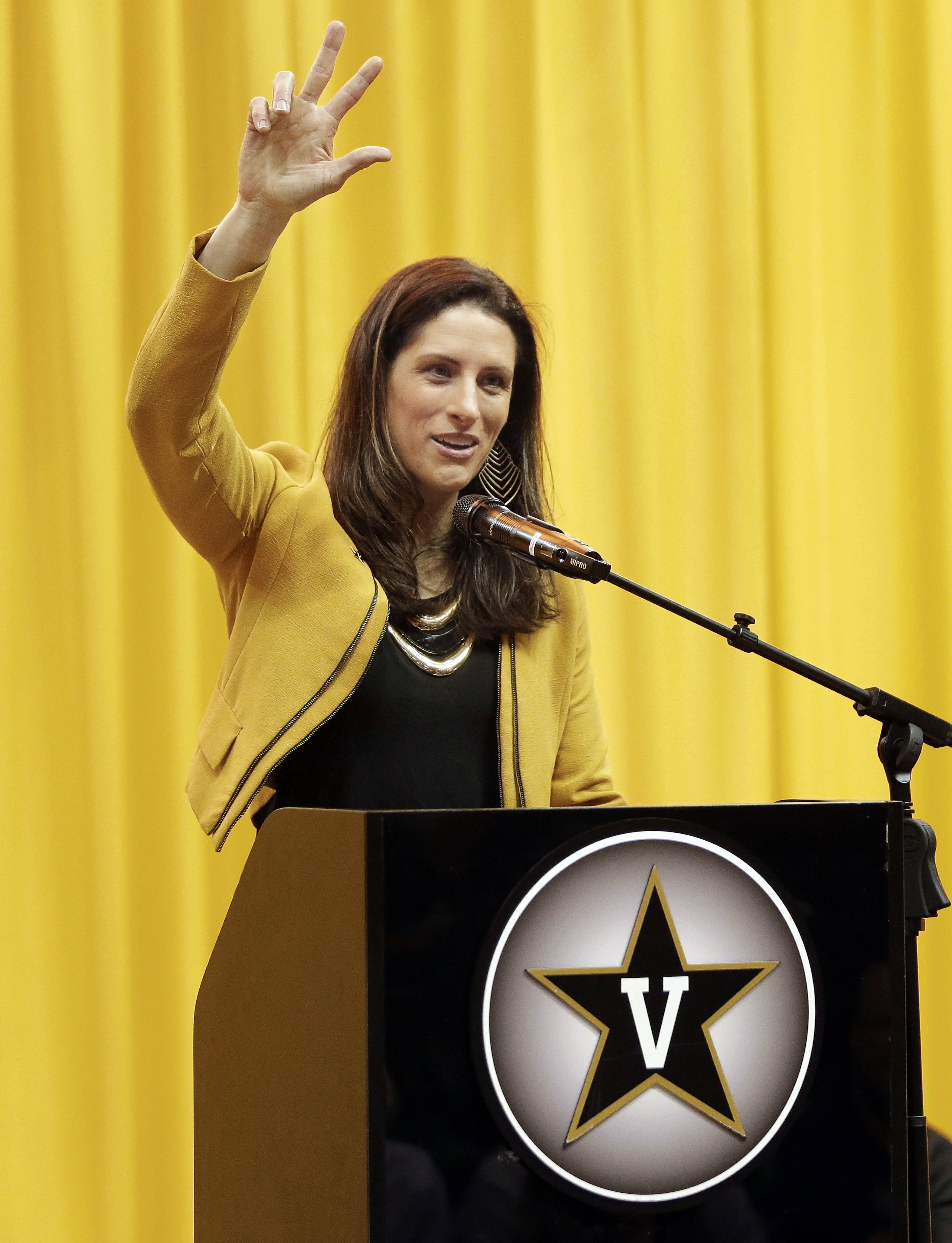 CORRECTS TO WHITE STILL COACHING IN THE WNBA - Stephanie White, head coach of the WNBA's Indiana Fever, gestures during an NCAA college baseball news conference where she was introduced as the new's women's basketball coach at Vanderbilt University, Wedne