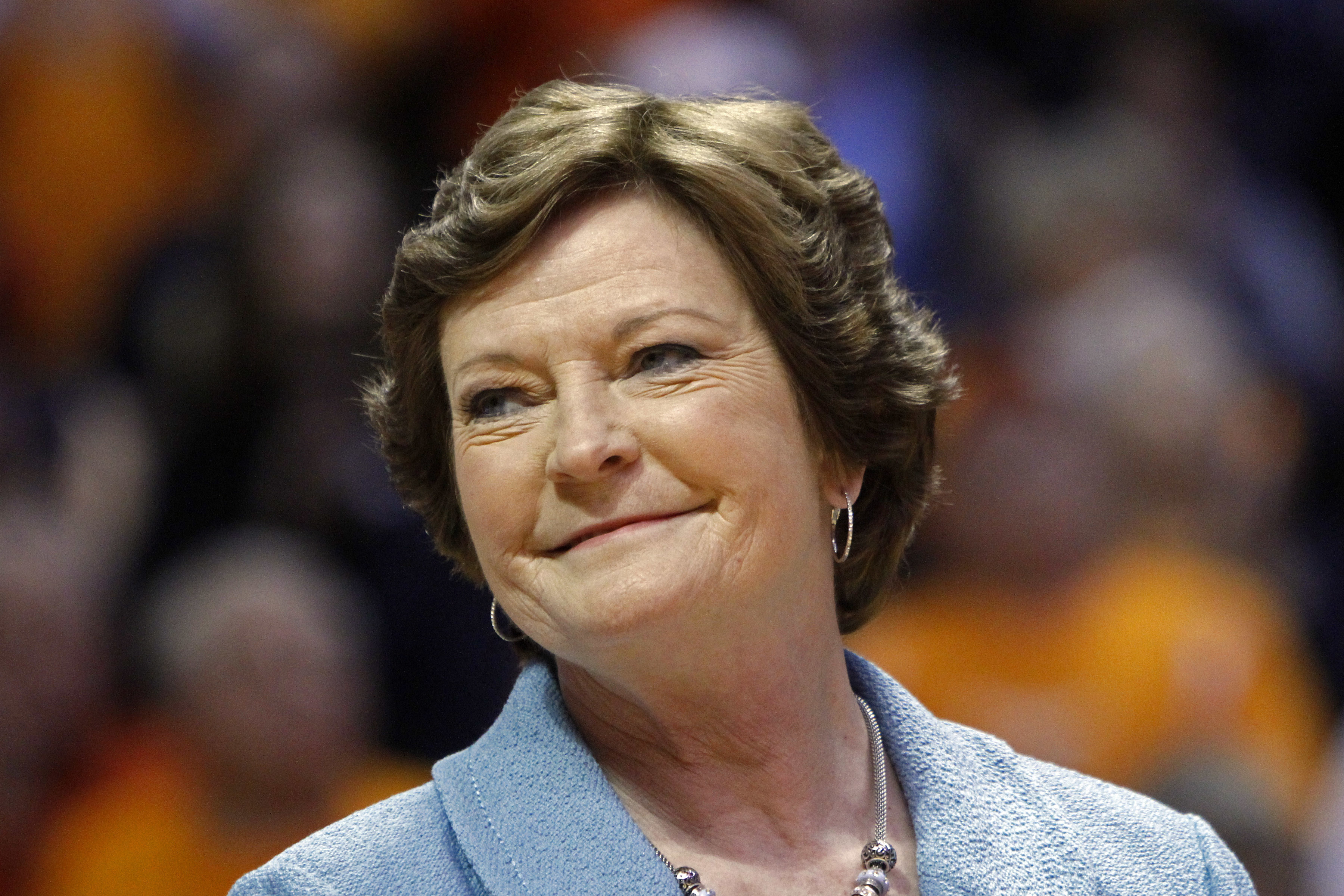 FILE - In this Jan. 28, 2013, file photo, former Tennessee women's basketball coach Pat Summitt smiles as a banner is raised in her honor before the team's NCAA college basketball game against Notre Dame in Knoxville, Tenn. Amid reports of Summitts failin