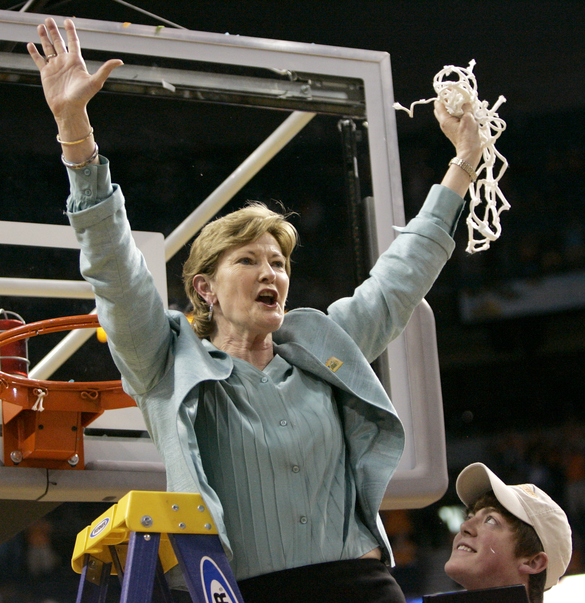 FILE - In this April 8, 2008, file photo, Tennessee coach Pat Summitt holds up the net as her son, Tyler, looks on after Tennessee beat Stanford 64-48 to win its eighth national women's basketball championship, at the NCAA women's basketball tournament Fi
