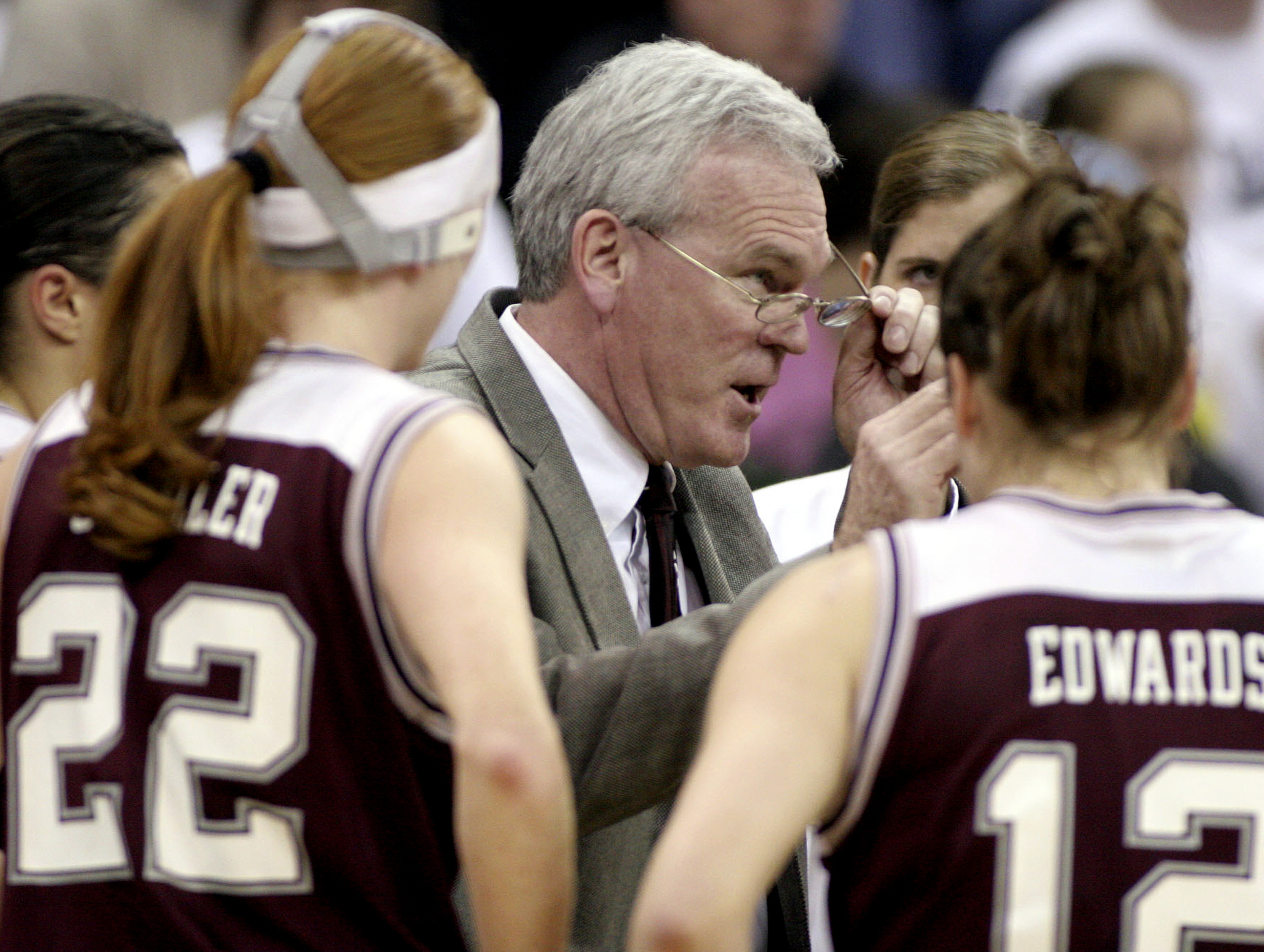 FILE - This March 19, 2005 file photo Montana head coach Robin Selvig adjusts his glasses as he talks to his team during a time-out in the first half against Vanderbilt at Bank of America Arena in Seattle. Montana's legendary women's basketball coach Selv