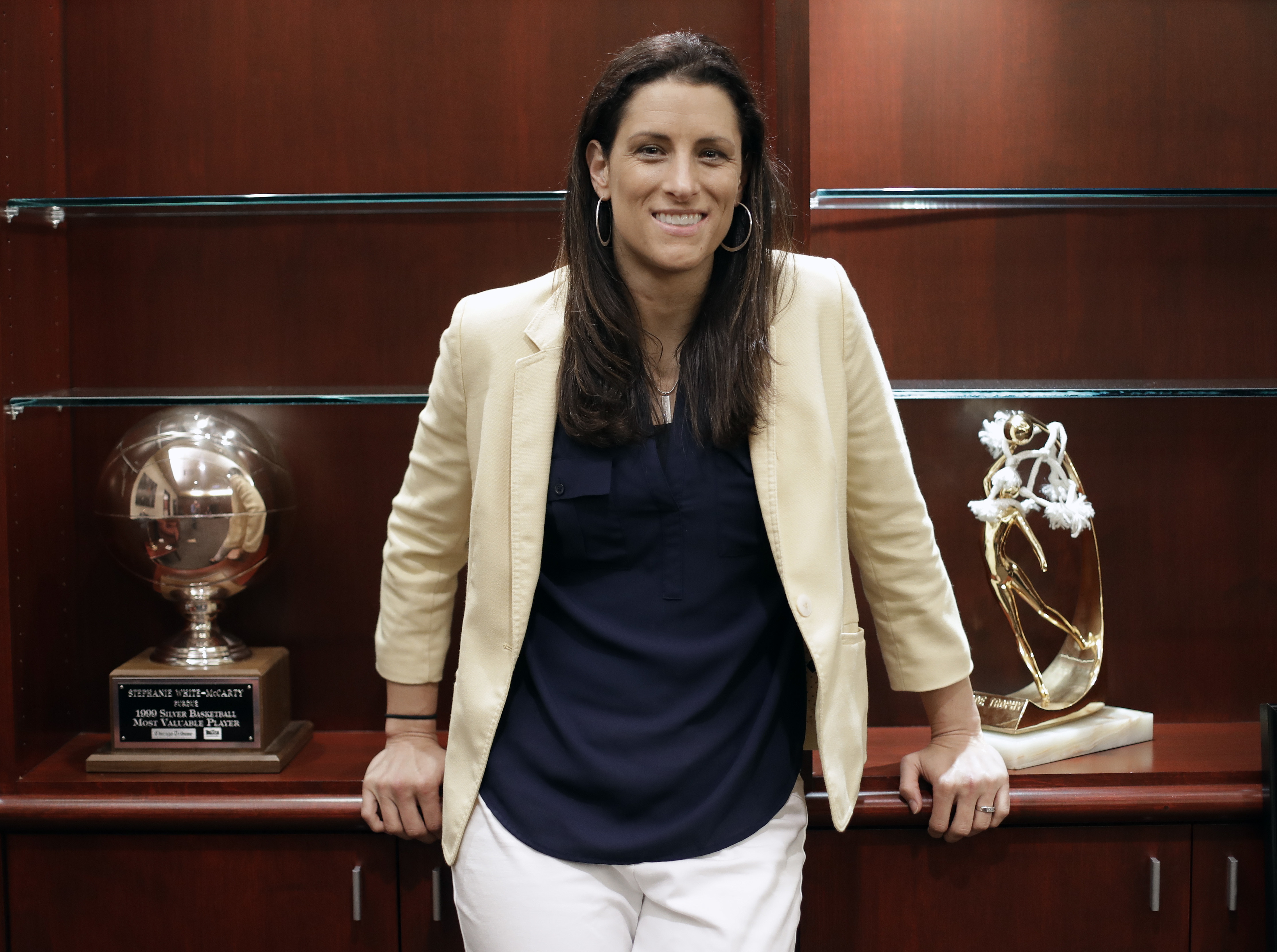 Stephanie White, who is finishing her season as the head coach of the WNBA's Indiana Fever and preparing as head coach of the Vanderbilt women's basketball team, poses with the few pieces of memorabilia she's had time to move into her Vanderbilt office Fr