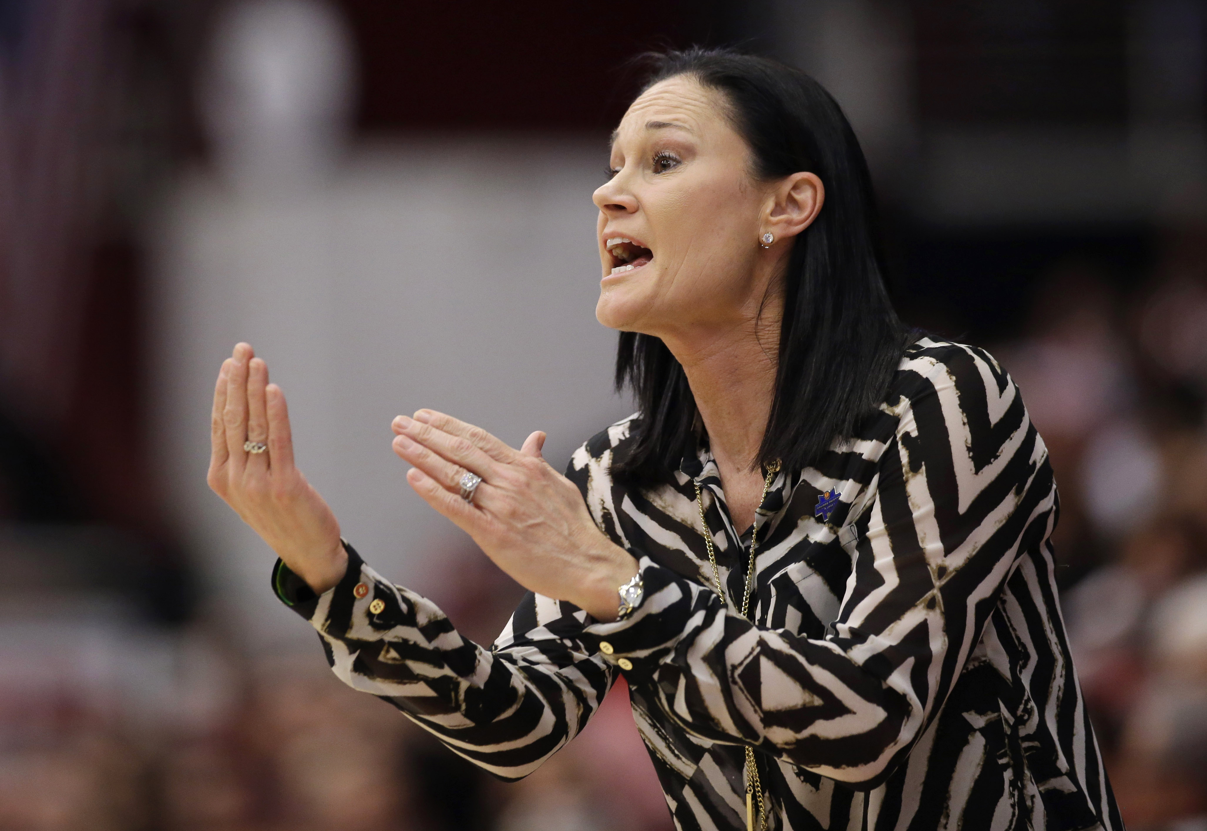 FILE - In this March 19, 2016, file photo, San Francisco coach Jennifer Azzi talks to her players during a first-round women's college basketball game against Stanford in the NCAA tournament in Stanford, Calif. Azzi has come out as gay, announcing she is
