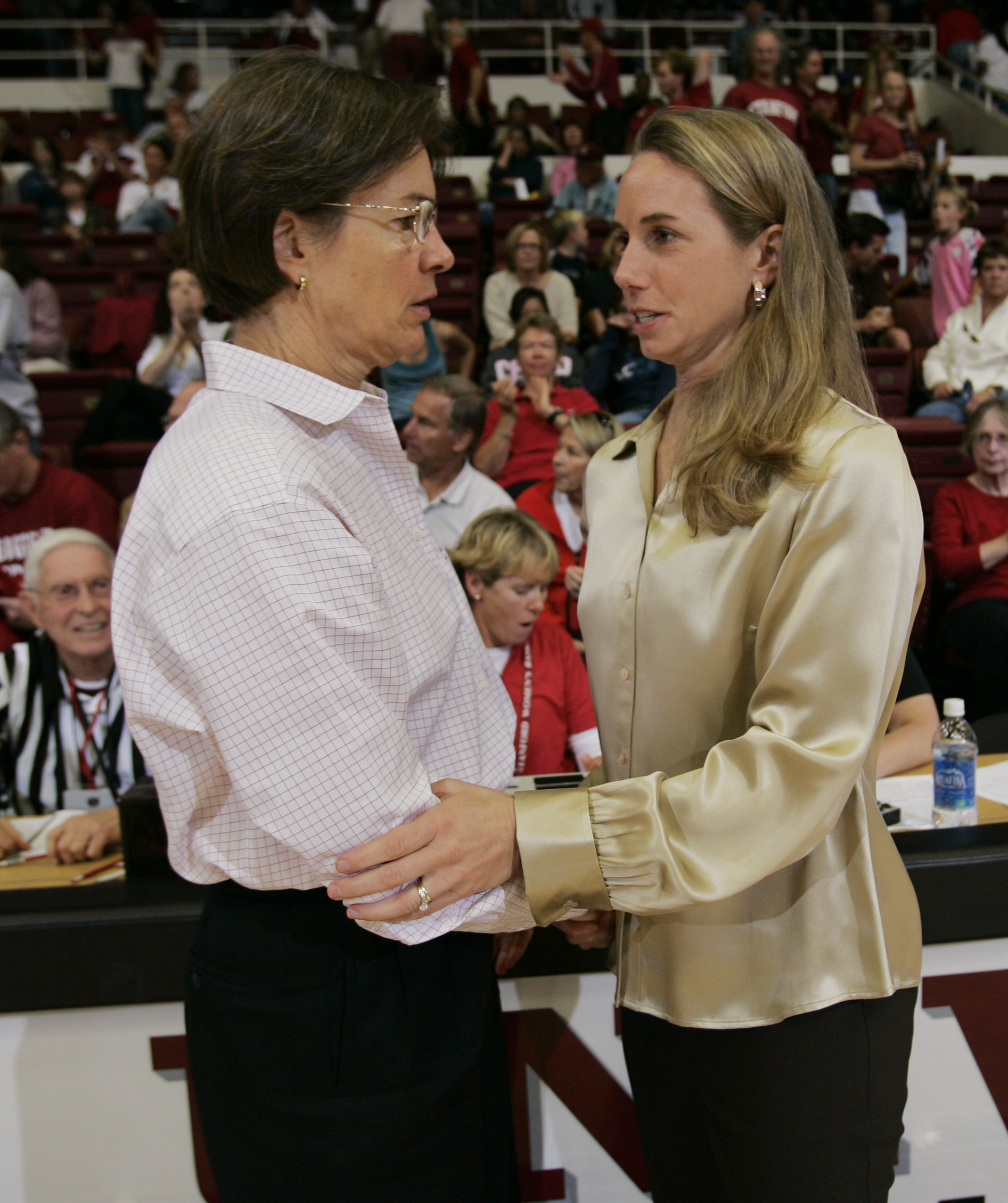 Chico State coach Molly Goodenbour, right, shake hands with Stanford coach Tara VanDerveer, left, after Stanford defeated Chico State 95-44 in an basketball game in Stanford, Calif., Saturday, Nov. 3, 2007. Goodenbour played for VanDerveer at Stanford sev
