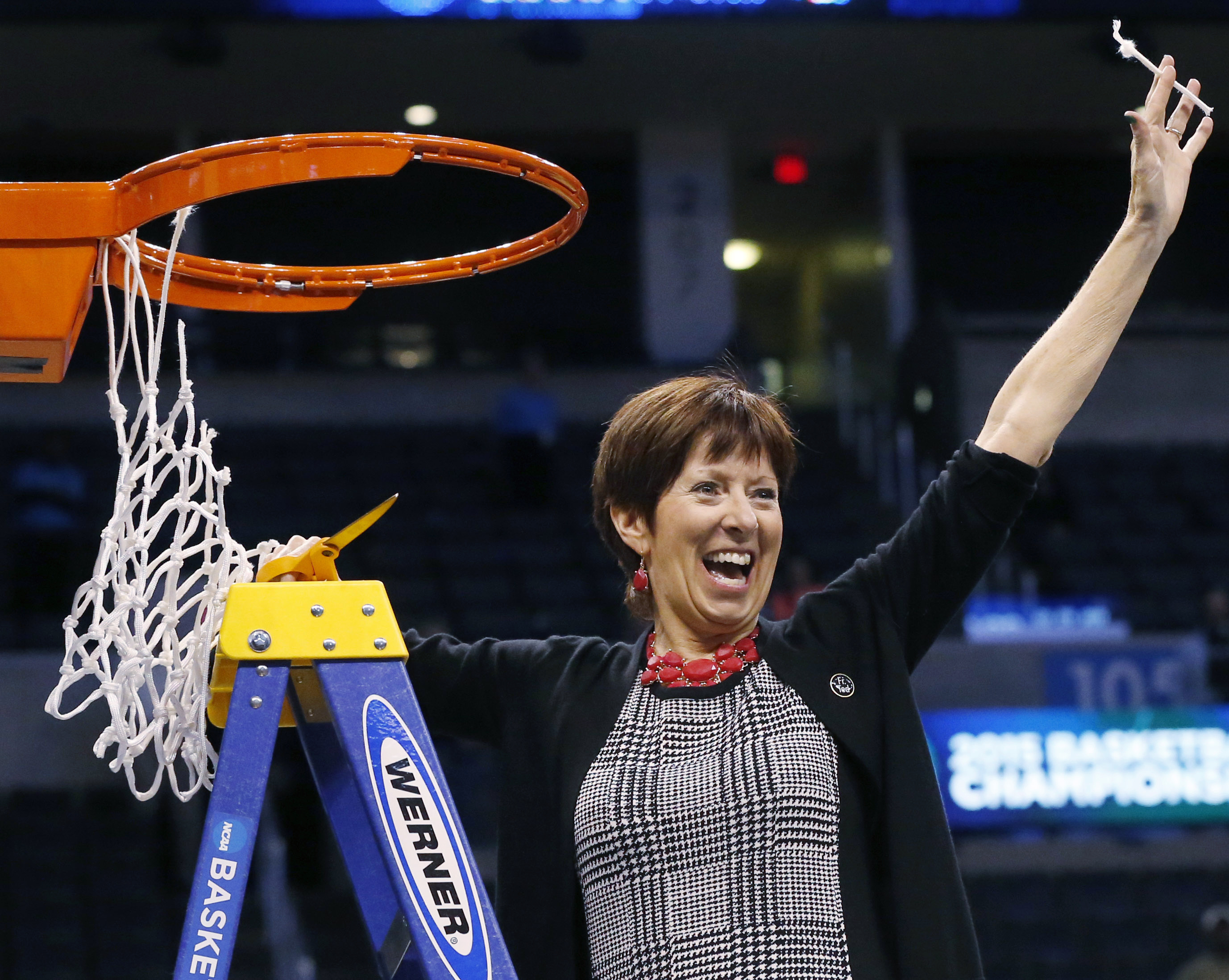 FILE - In this March 29, 2015, file photo, Notre Dame coach Muffet McGraw holds up part of the net after Notre Dame defeated Baylor 77-68 in a regional final in the NCAA women's college basketball tournament, in Oklahoma City. Notre Dame won a national ch